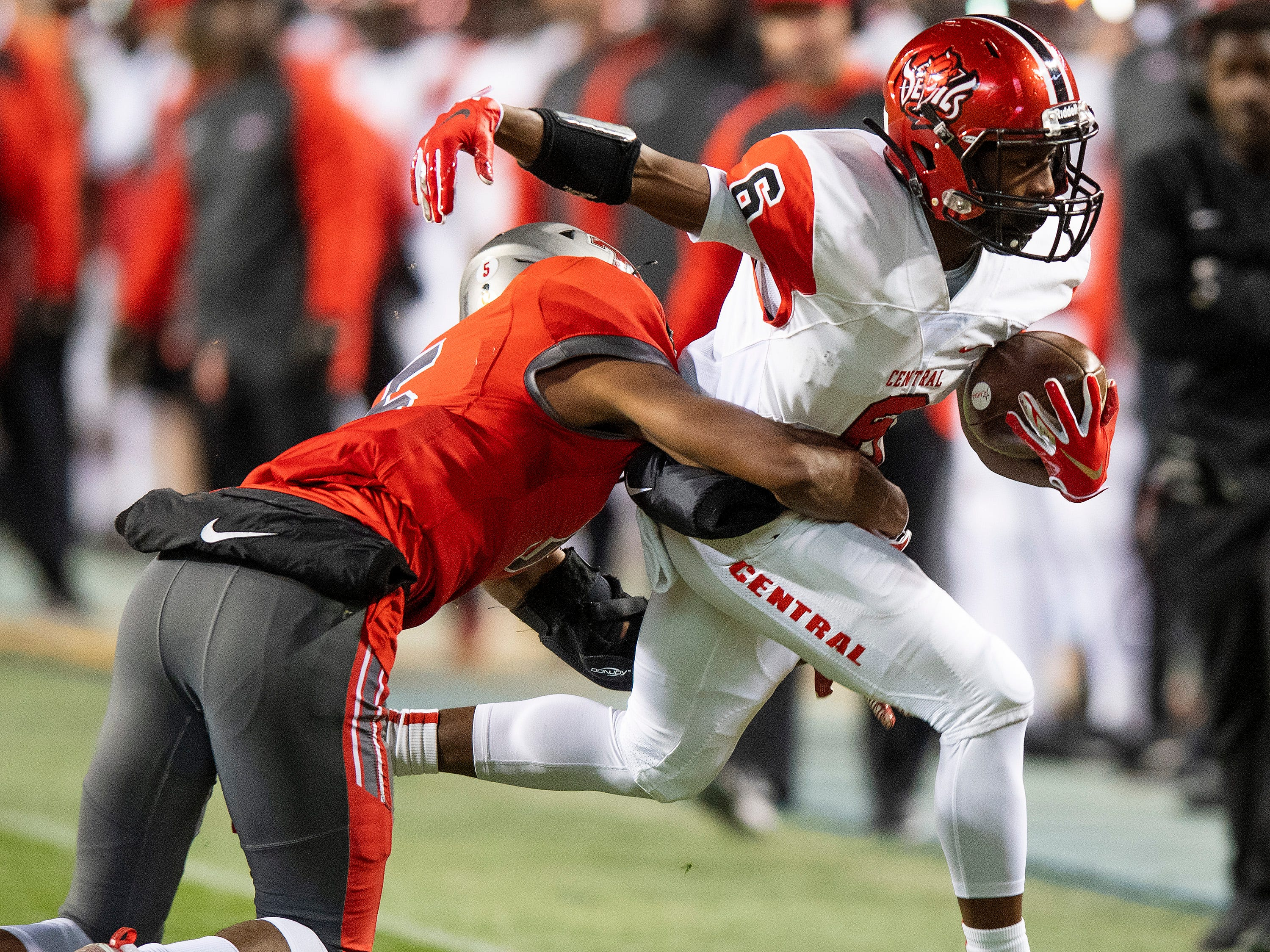 Central-Phenix City's Marsh Robert is forced out of bounds by Thompson's Nathan Riddle during the AHSAA Class 7A State Championship Football Game at Jordan Hare Stadium in Auburn, Ala., on Wednesday evening December 5, 2018.