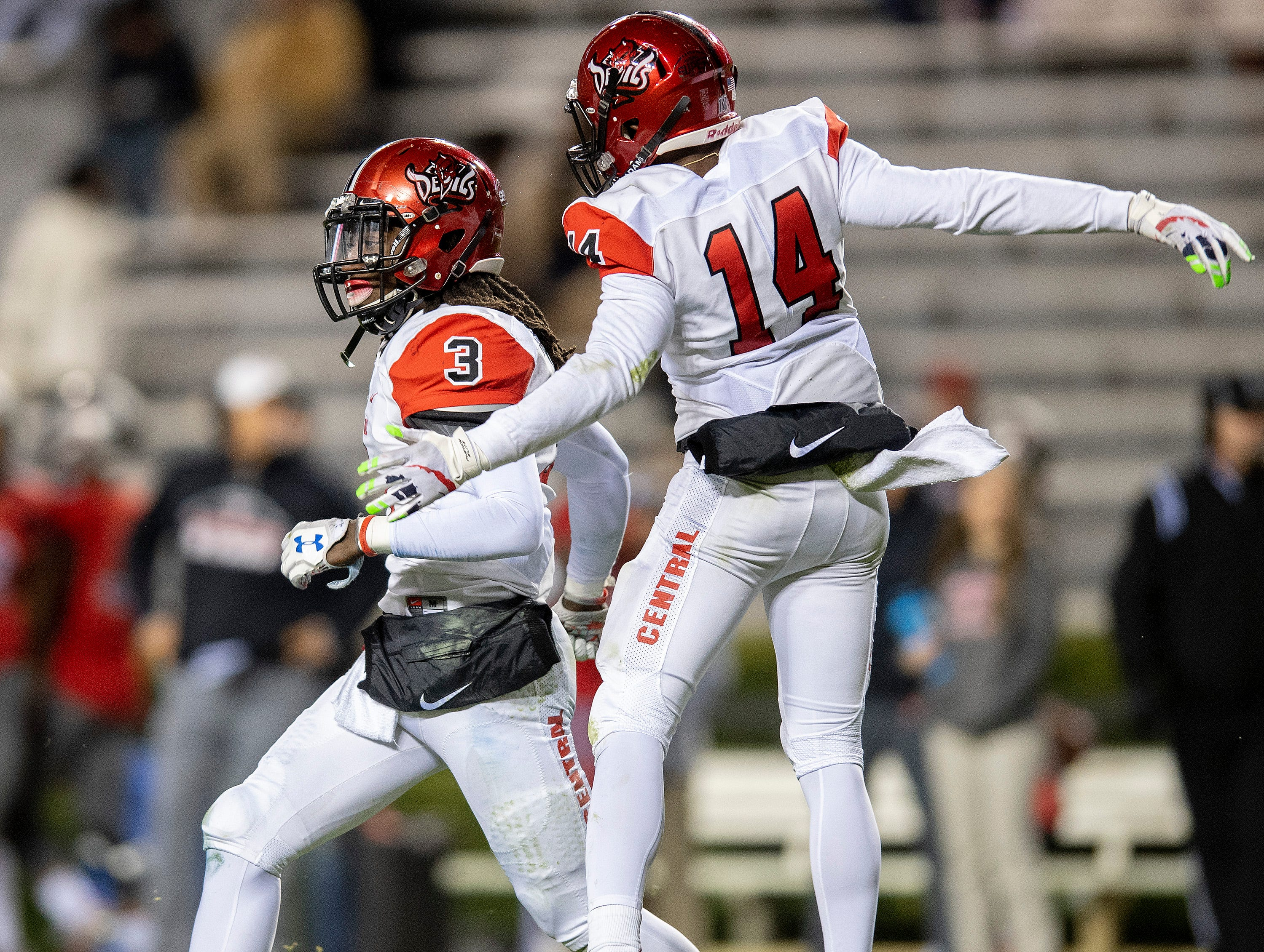 Central-Phenix City's Marquez Henry celebrates after returning an interception for a touchdown against Thompson during the AHSAA Class 7A State Championship Football Game at Jordan Hare Stadium in Auburn, Ala., on Wednesday evening December 5, 2018.