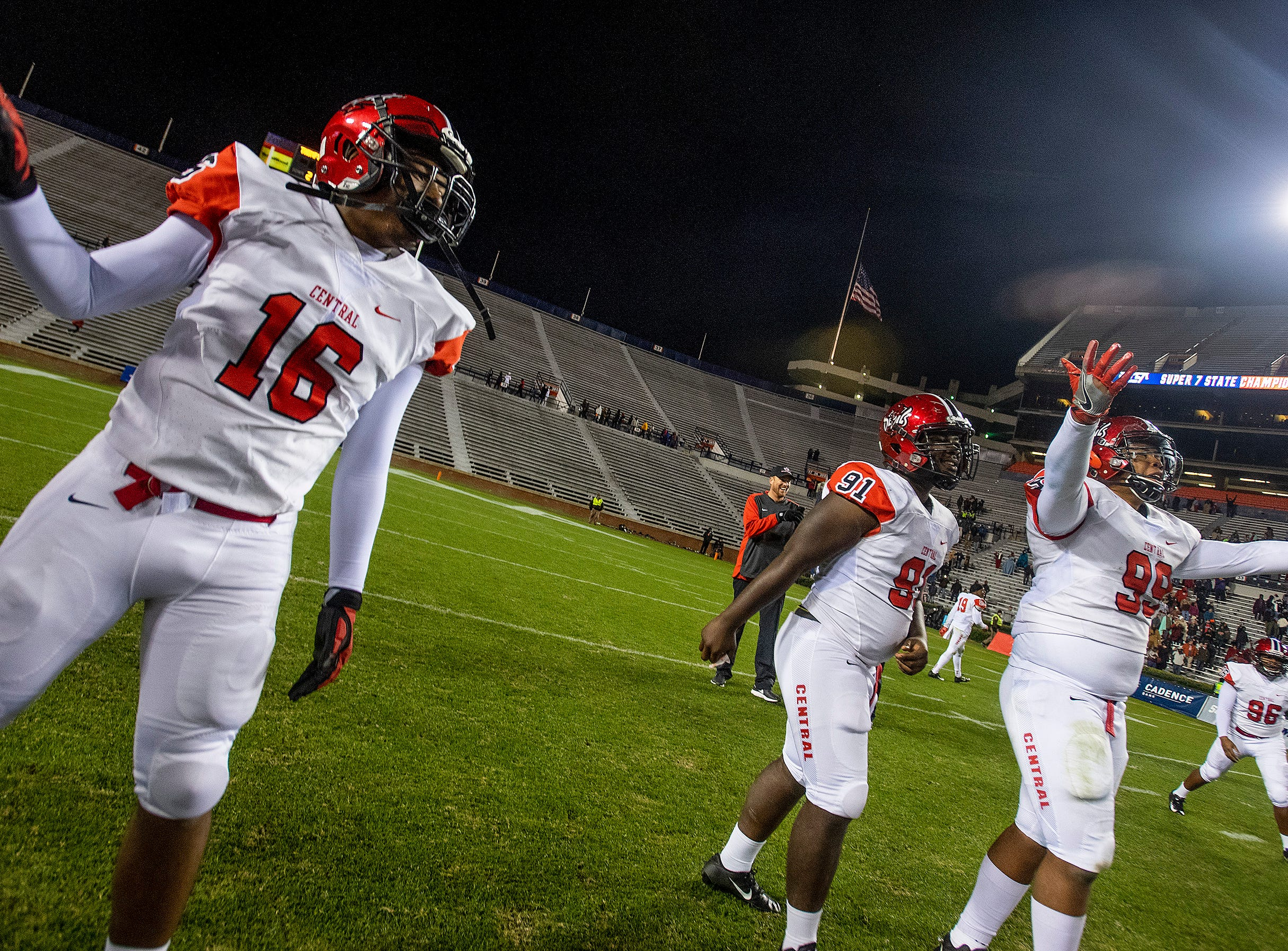 Central-Phenix City players celebrate defeating Thompson in the AHSAA Class 7A State Championship Football Game at Jordan Hare Stadium in Auburn, Ala., on Wednesday evening December 5, 2018.