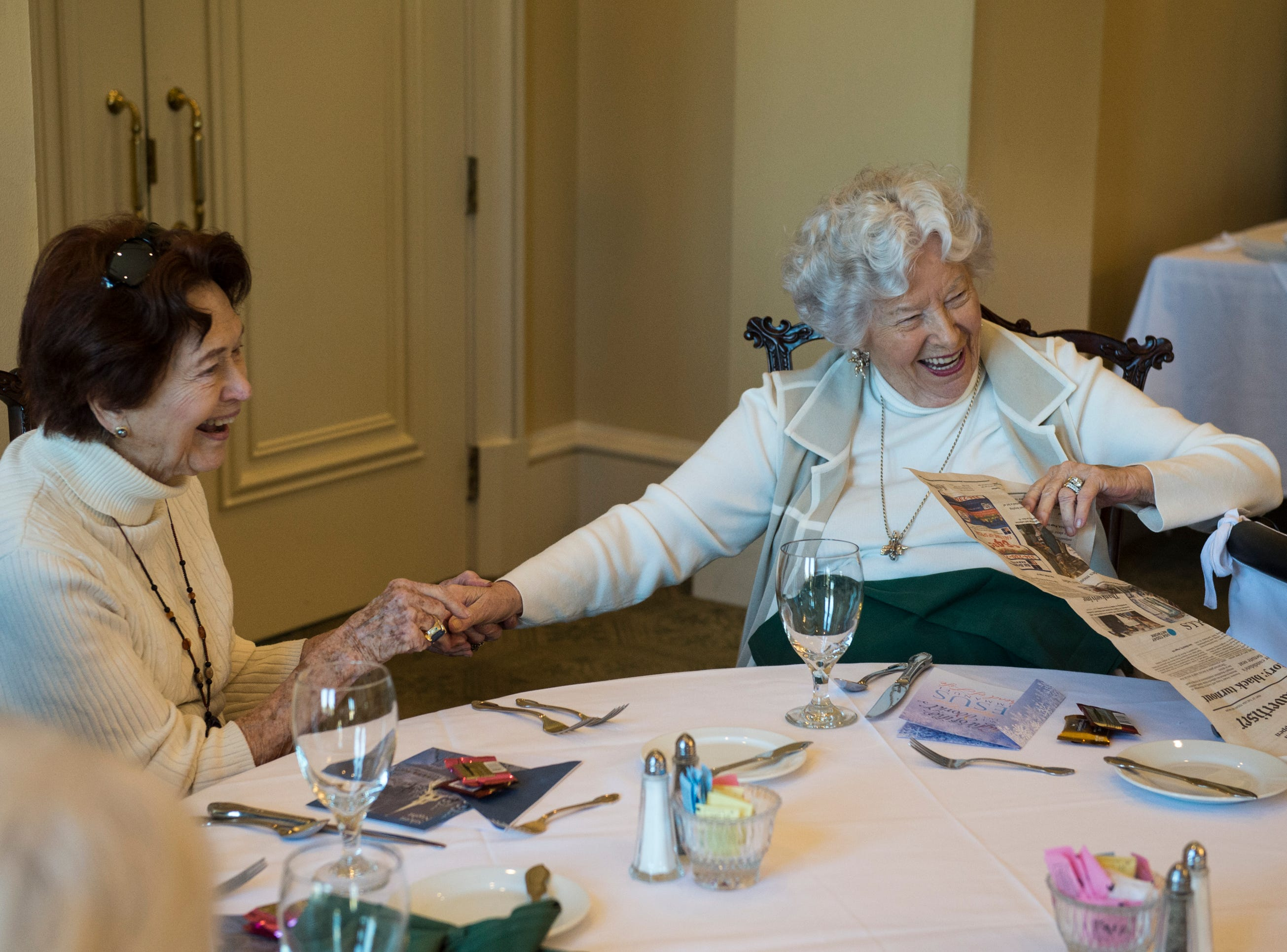 Peggy Joseph, left, and Maureen Parks chat with friends during lunch at Montgomery Country Club in Montgomery, Ala., on Wednesday, Dec. 5, 2018.