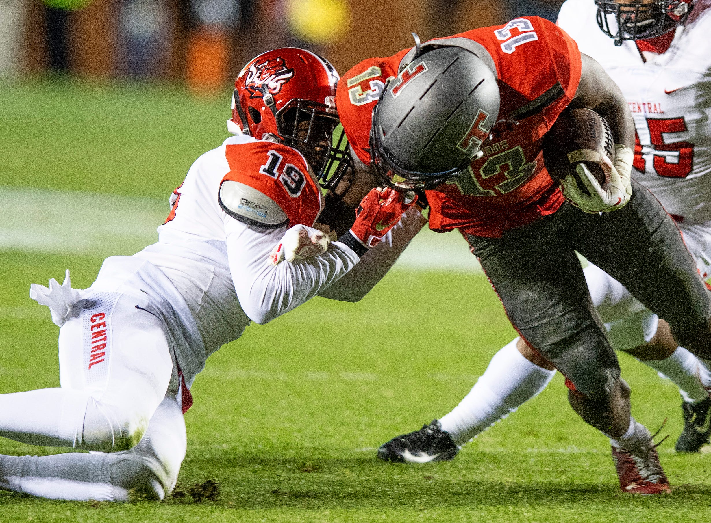 Central-Phenix City's Terrell Covington facemarks Thompson's Shadrick Byrd during the AHSAA Class 7A State Championship Football Game at Jordan Hare Stadium in Auburn, Ala., on Wednesday evening December 5, 2018.