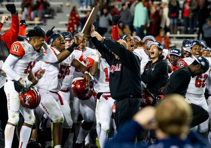 Central-Phenix City coach Jamey DuBose presents his team with their trophy after they defeated Thompson in the AHSAA Class 7A State Championship Football Game at Jordan Hare Stadium in Auburn, Ala., on Wednesday evening December 5, 2018.