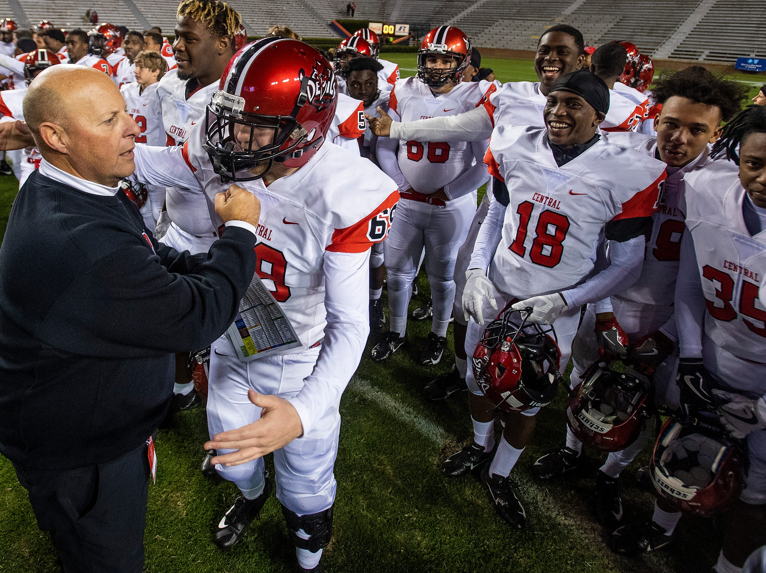 Central-Phenix City coach Jamey DuBose with his players after defeating Thompson in the AHSAA Class 7A State Championship Football Game at Jordan Hare Stadium in Auburn, Ala., on Wednesday evening December 5, 2018.