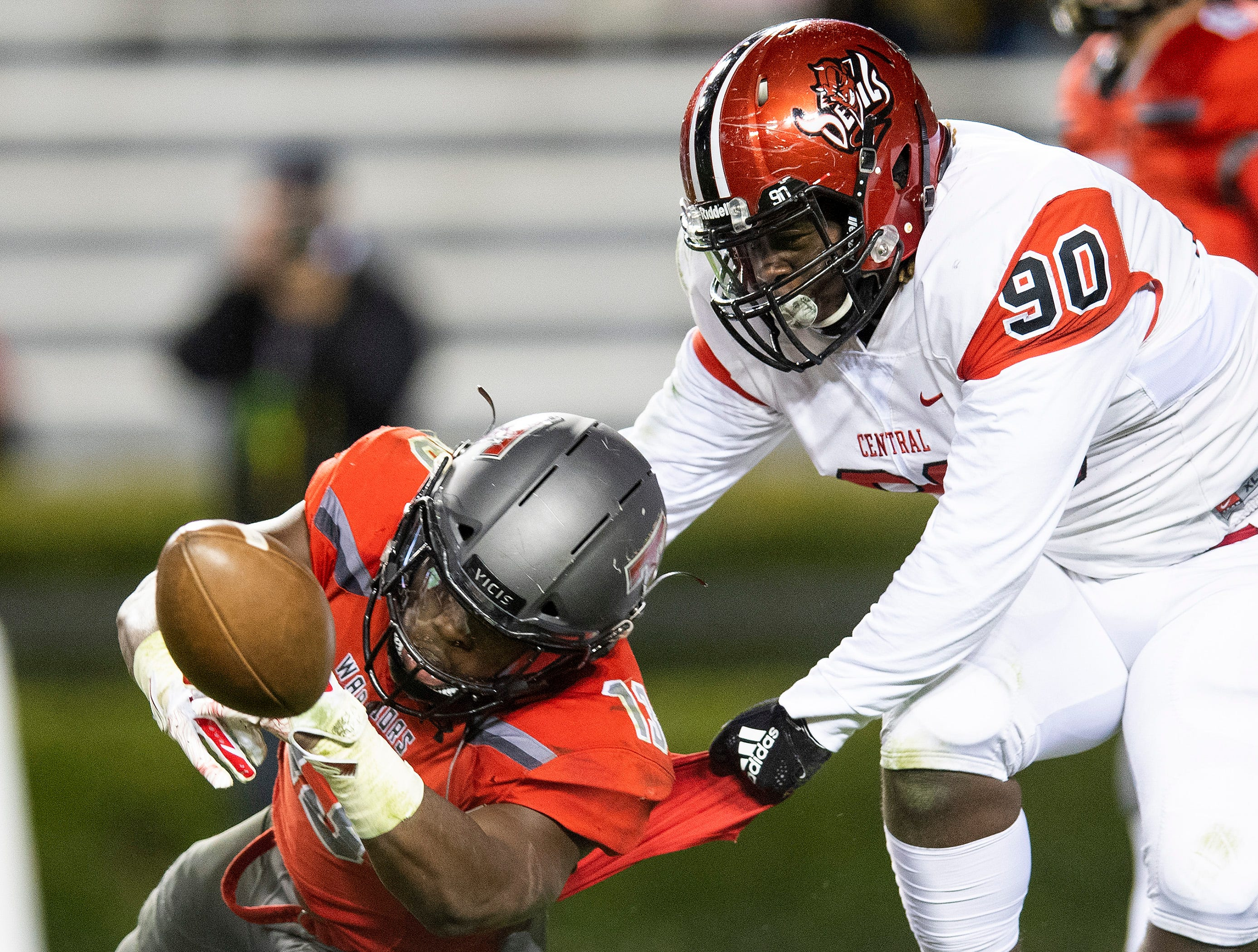 Thompson's Shadrick Byrd fumbles the ball against Central-Phenix City's Vontavious Maddox during the AHSAA Class 7A State Championship Football Game at Jordan Hare Stadium in Auburn, Ala., on Wednesday evening December 5, 2018.