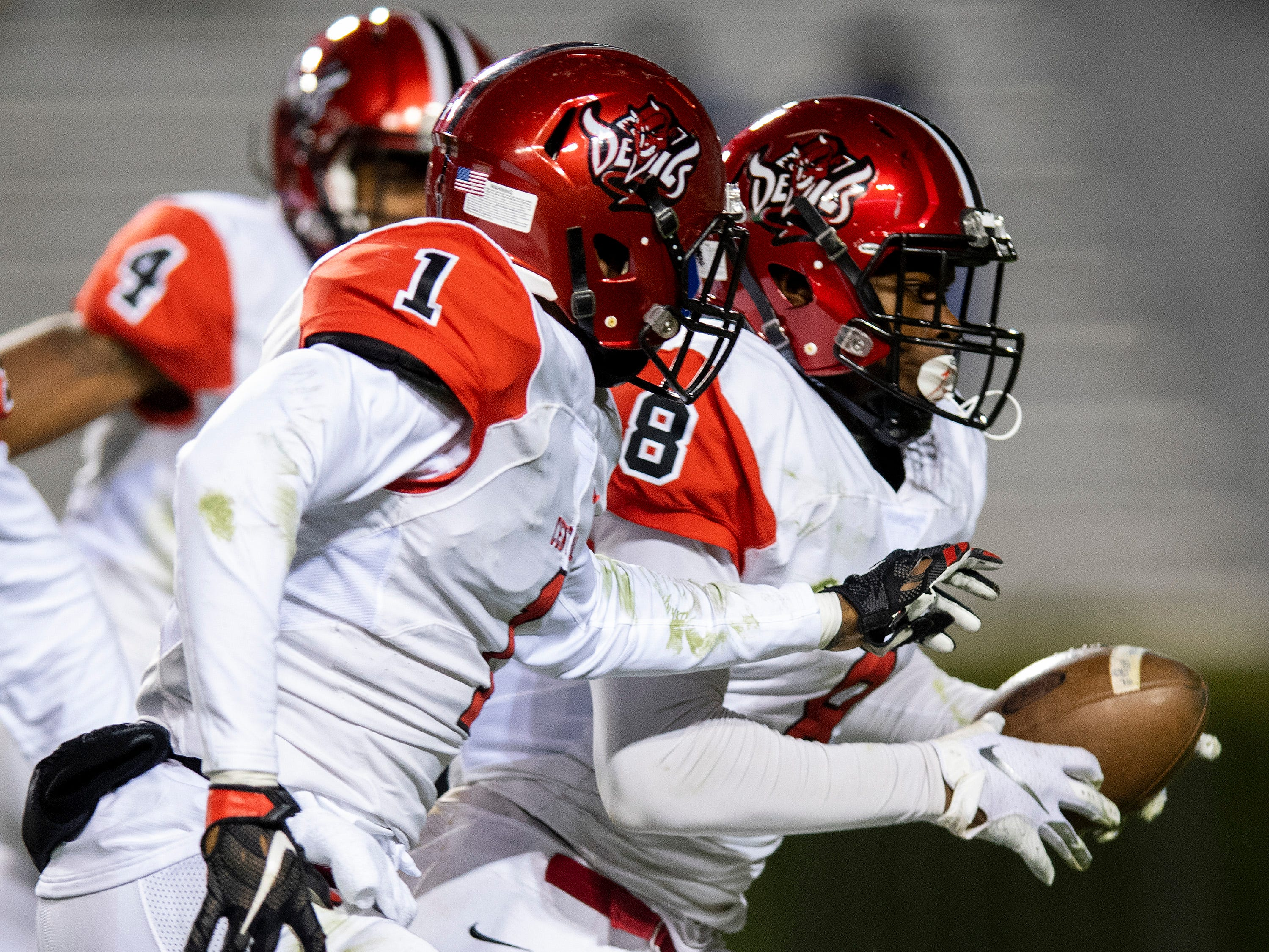 Central-Phenix City's Trevon Miller scores a touchdown on a fumble recovery against Thompson during the AHSAA Class 7A State Championship Football Game at Jordan Hare Stadium in Auburn, Ala., on Wednesday evening December 5, 2018.