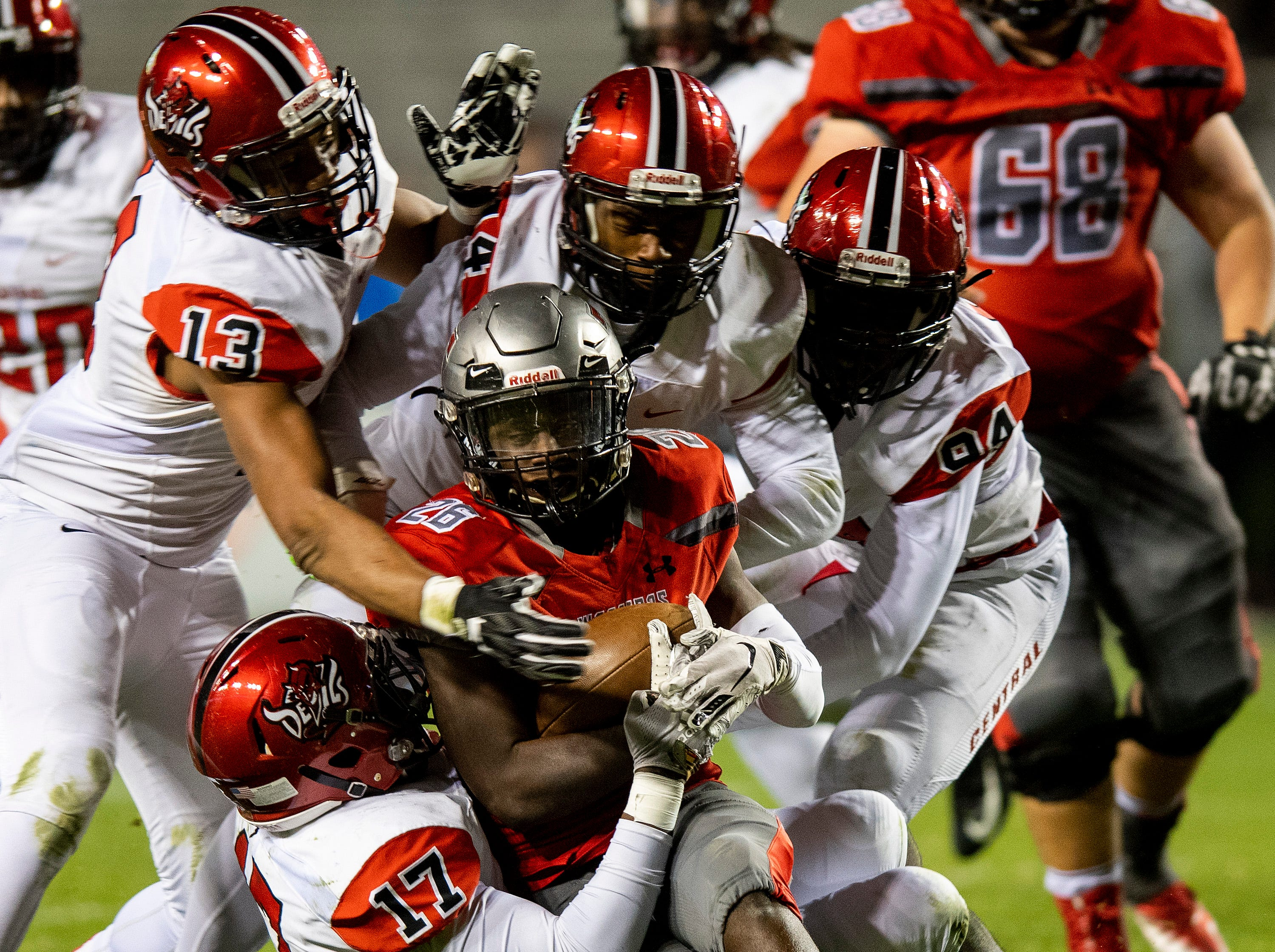 Thompson's Jarrett Crocket is swarmed under by Central-Phenix City defenders during the AHSAA Class 7A State Championship Football Game at Jordan Hare Stadium in Auburn, Ala., on Wednesday evening December 5, 2018.