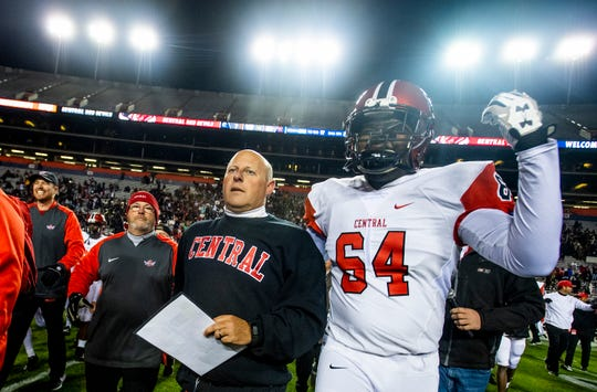 Central-Phenix City's Ras Freedom Rolland and  coach Jamey DuBose take the field after defeating Thompson in the AHSAA Class 7A State Championship Football Game at Jordan Hare Stadium in Auburn, Ala., on Wednesday evening December 5, 2018.