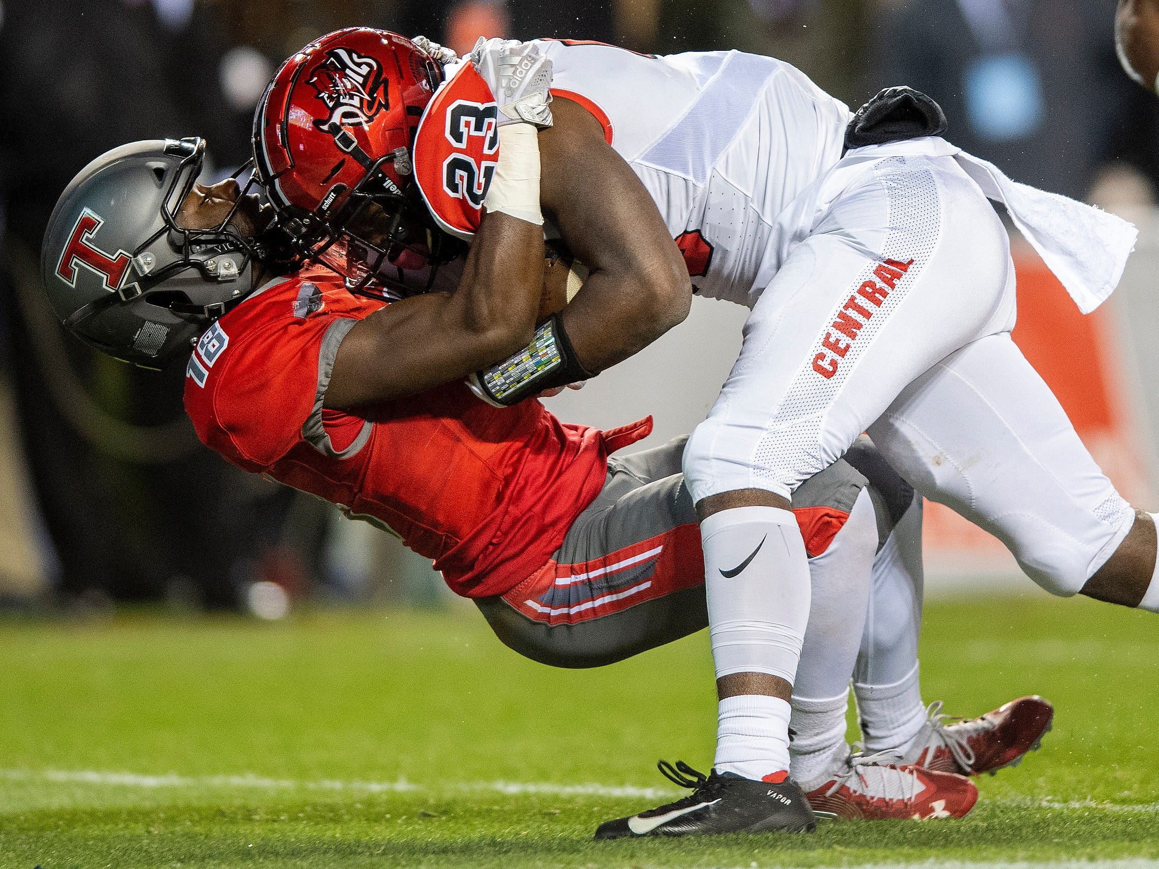 Central-Phenix City's Joseph McKay runs over Thompson's Elijah Clayton as he scores a touchdown during the AHSAA Class 7A State Championship Football Game at Jordan Hare Stadium in Auburn, Ala., on Wednesday evening December 5, 2018.
