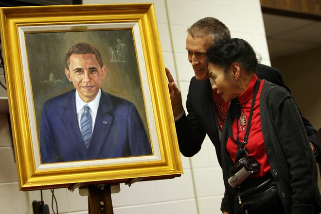In this photo from 2009, photographer/artist Ruth Chin and then-Director of Career Center and Extended Services Dale Basham unveil Chin's portrait of President Barack Obama during a ceremony at the Muncie Area Career Center.