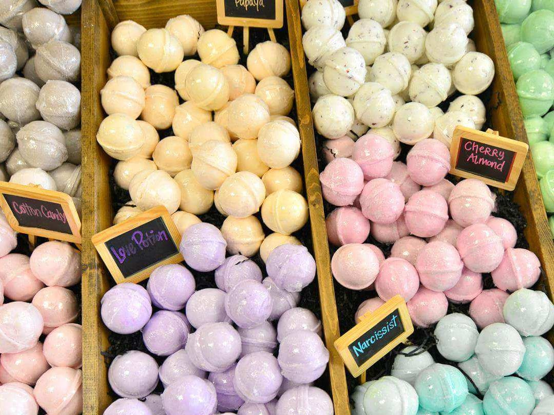 Buff City Soap offers bath items, like bath bombs, in a variety of scents. All items are natural and paraben free.