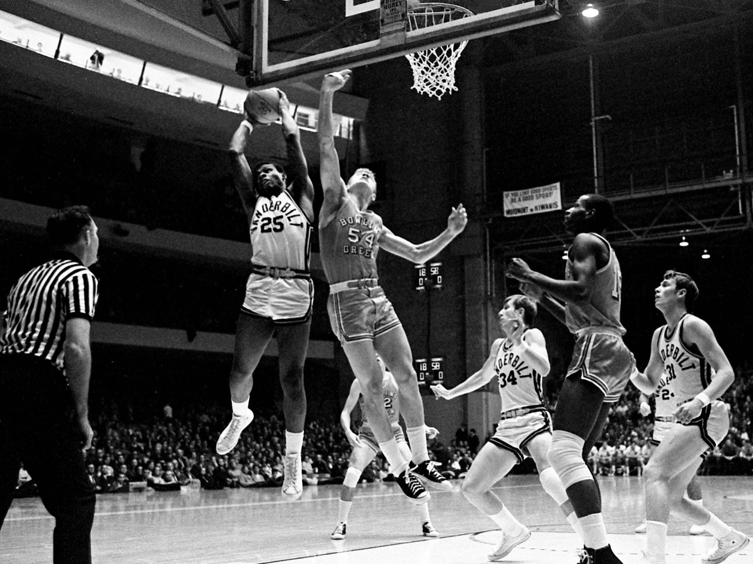 Vanderbilt junior forward Perry Wallace (25) grabs another rebound before getting hurt in the Commodores' 92-67 victory over Bowling Green State at Memorial Gym on Dec. 16, 1968.