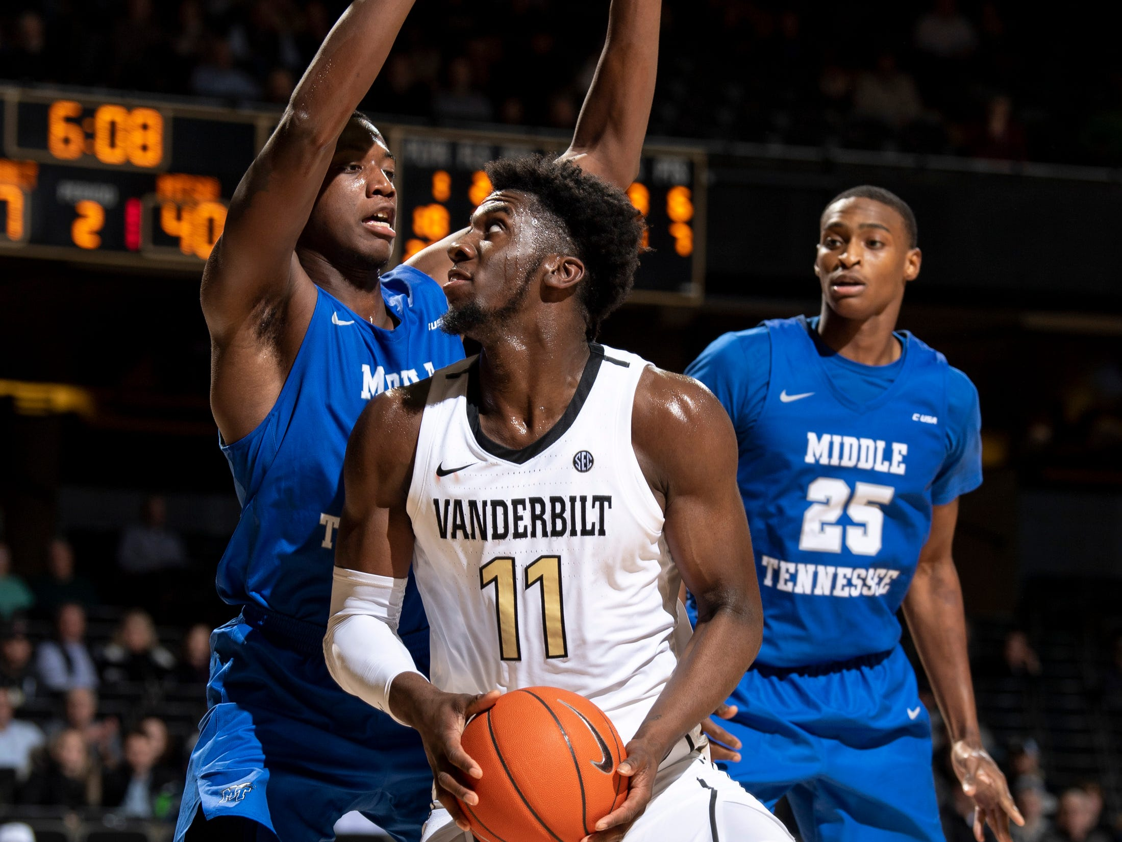 MTSU forward Reggie Scurry (22) guards Vanderbilt forward Simisola Shittu (11) during the second half at Memorial Gym in Nashville, Tenn., Wednesday, Dec. 5, 2018.