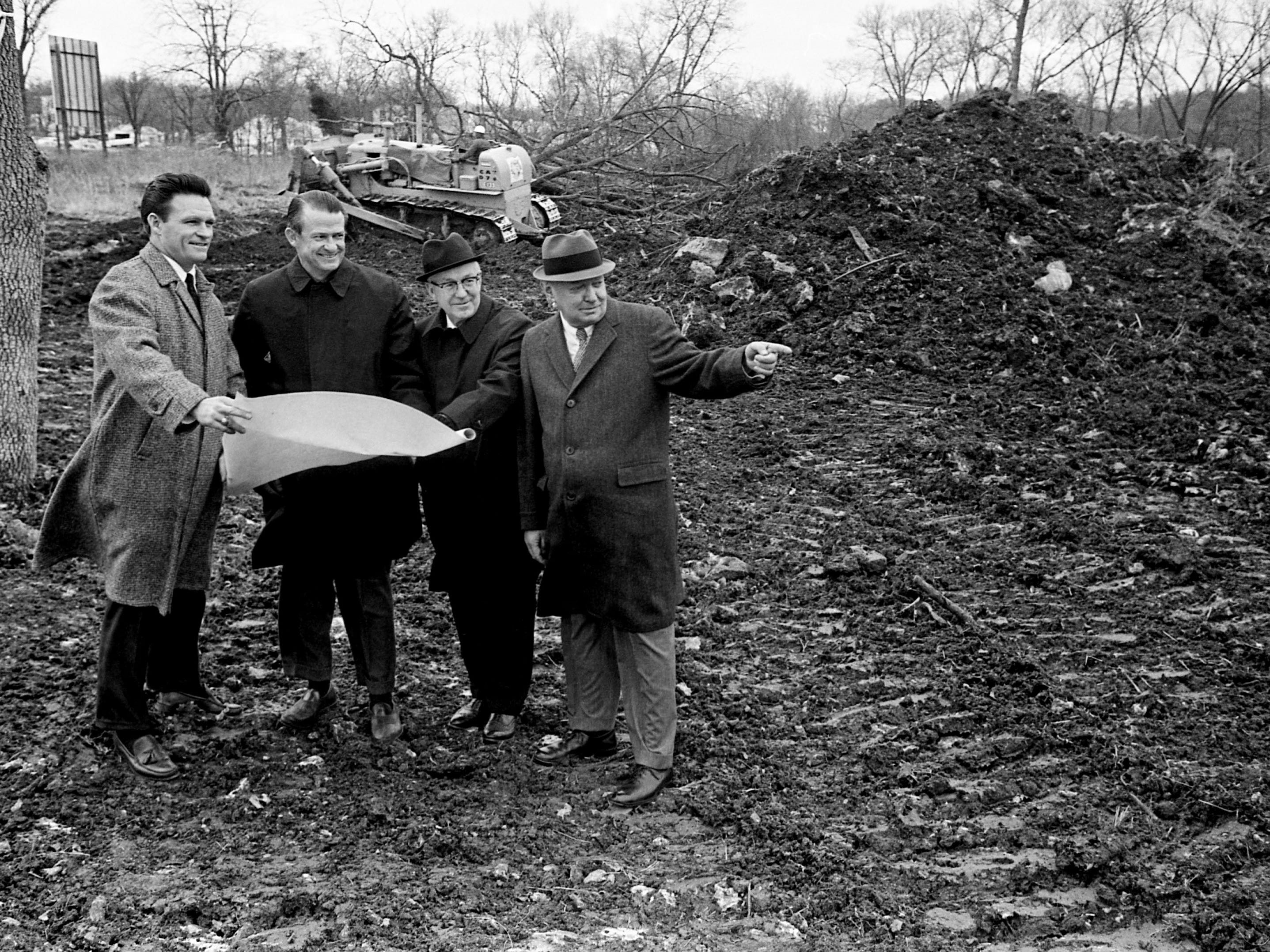 Members of Nashville YMCA's capital funds campaign look over the Green Hills site being cleared for recreational activities Dec. 23, 1968, and eventually for a $1.4 million development. They are Jack Petterson, left, Warren Taylor, the Rev. Frank Drowota and R.M. Crichton.