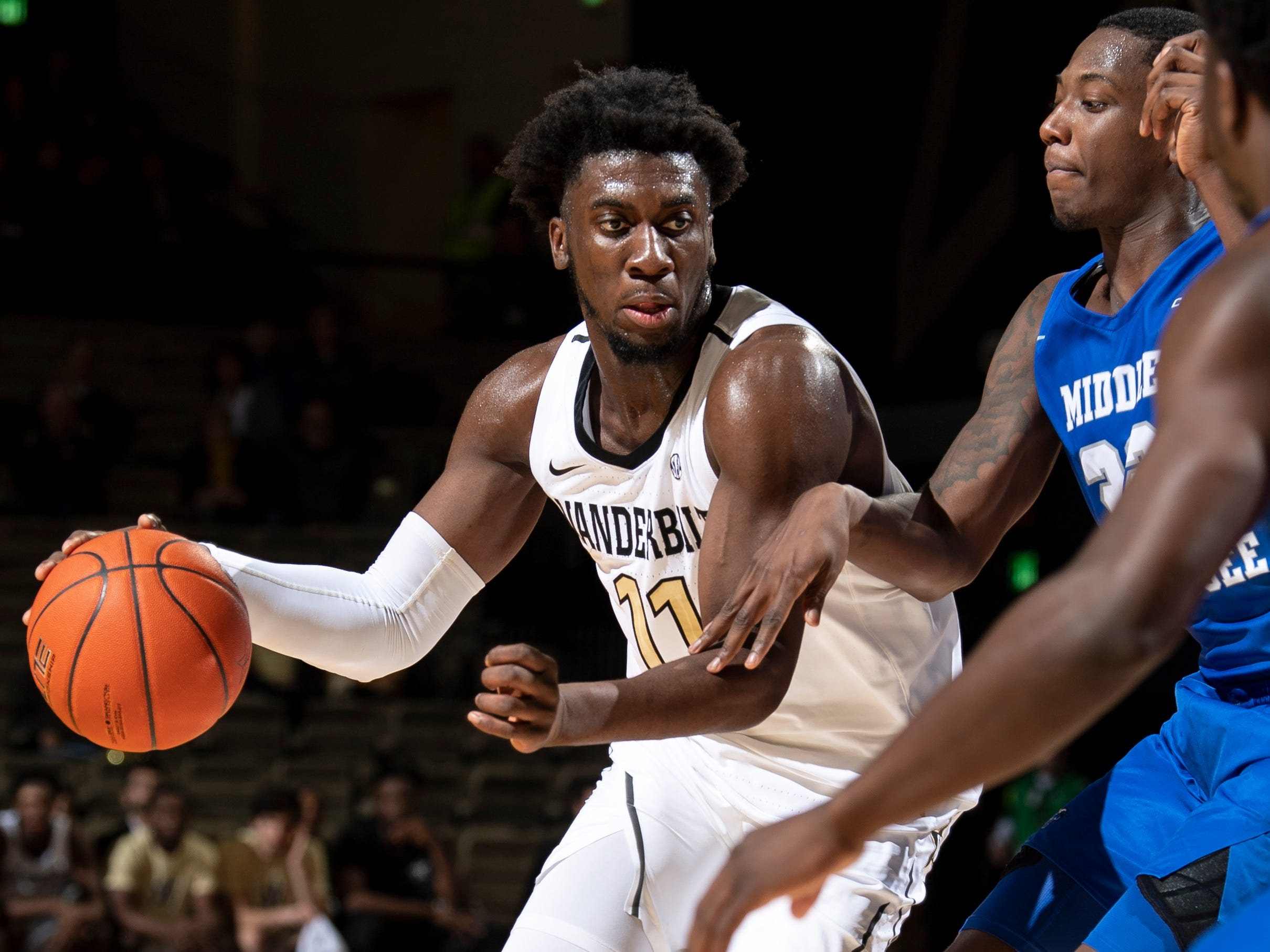 Vanderbilt forward Simisola Shittu (11) advances into MTSU forward Reggie Scurry (22) during the first half at Memorial Gym in Nashville, Tenn., Wednesday, Dec. 5, 2018.