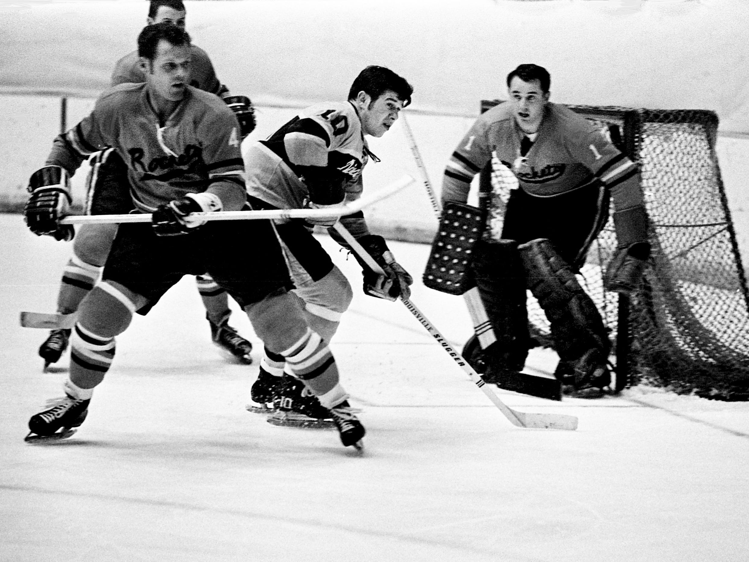 Nashville Dixie Flyers winger Andre Lajeunesse (10) positions himself in the middle of a trio of defense from Jacksonville Rockets, including defenseman Stan Melanchuck (4) and goalie Harrison Gray. The Flyers won 8-3 before a Christmas Day crowd of 2,173 at Municipal Auditorium Dec. 25, 1968.