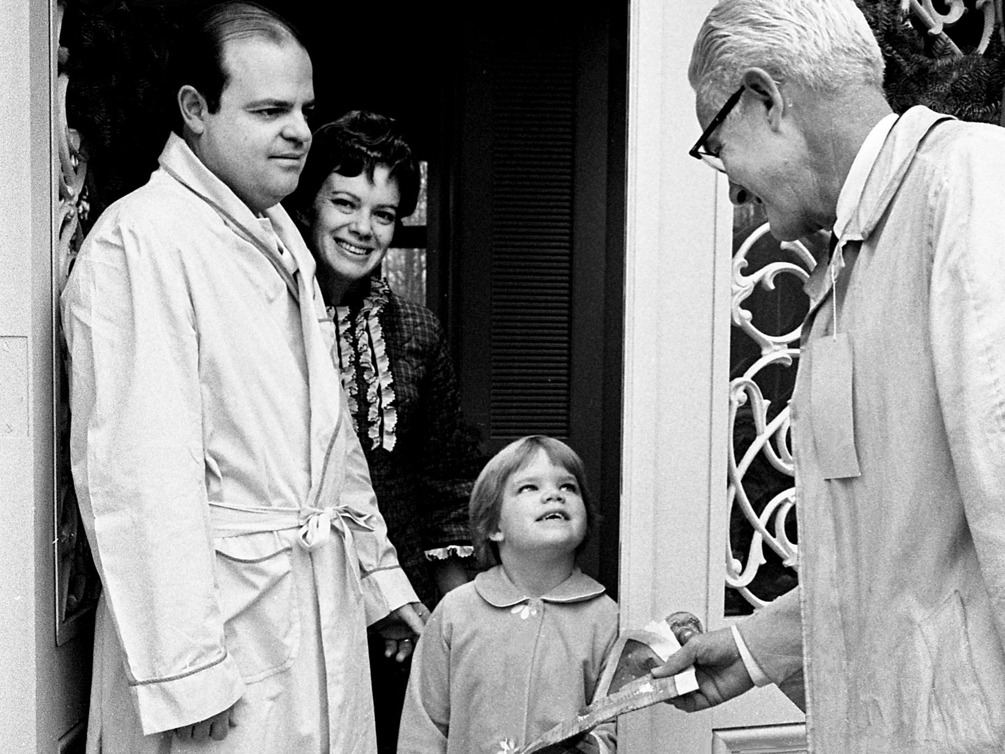J.E. Wallace, right, Big Brothers second vice president, was an early visitor to the home of Mr. and Mrs. Sydney F. Keeble Jr. on Truxton Place Dec. 22, 1968 as he sells a Big Brothers Christmas tabloid to their five-year-old daughter, Grace.