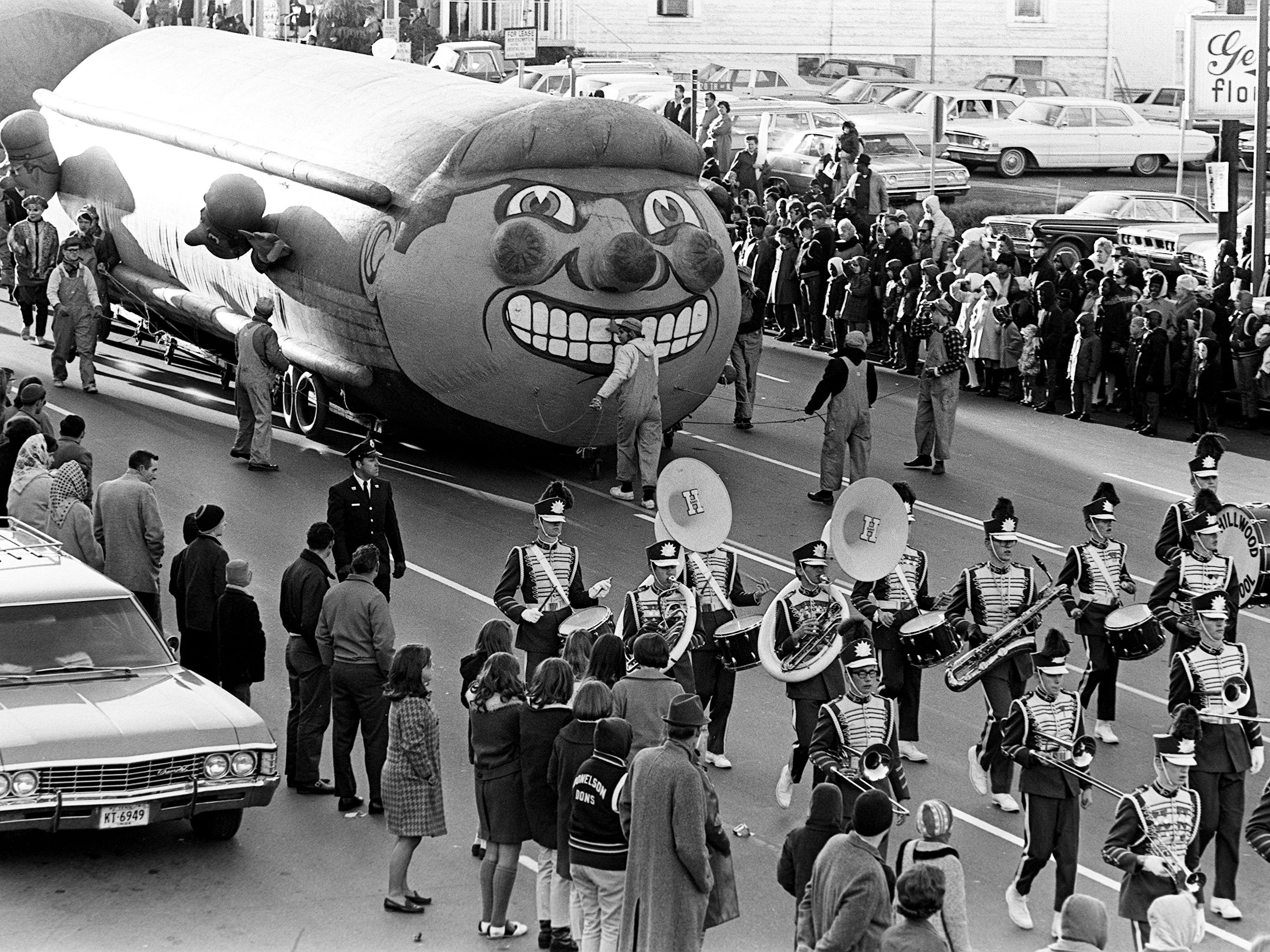 A grinning giant locomotive and the Hillwood High School marching band delighted some of the estimated crowd of 125,000 during the 16th annual Nashville Christmas parade Dec. 8, 1968.