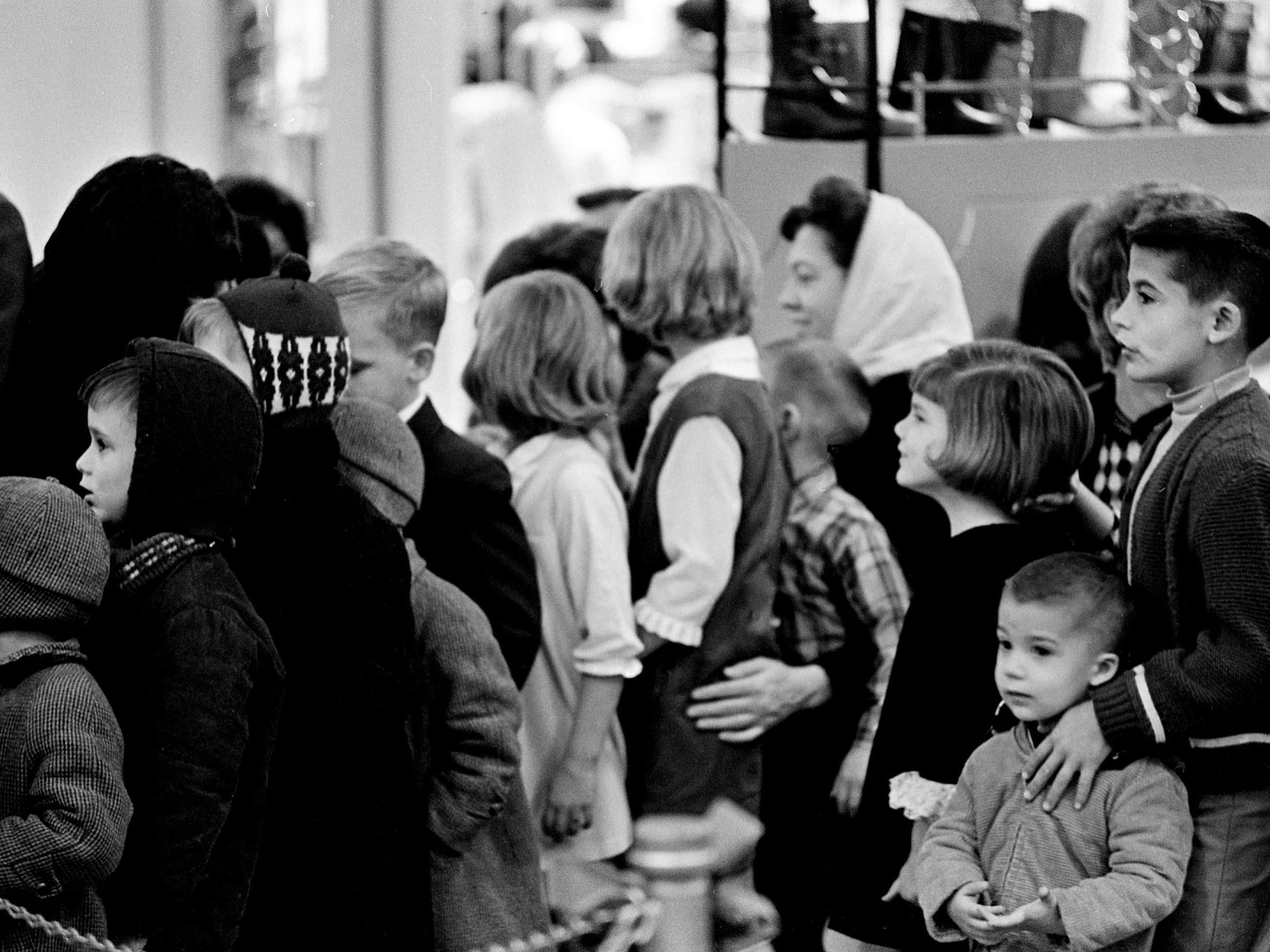 A crowd of youngsters is forming a long line as they wait to tell Santa Claus what they want for Christmas at one of the downtown Nashville's department stores Dec. 7, 1968.