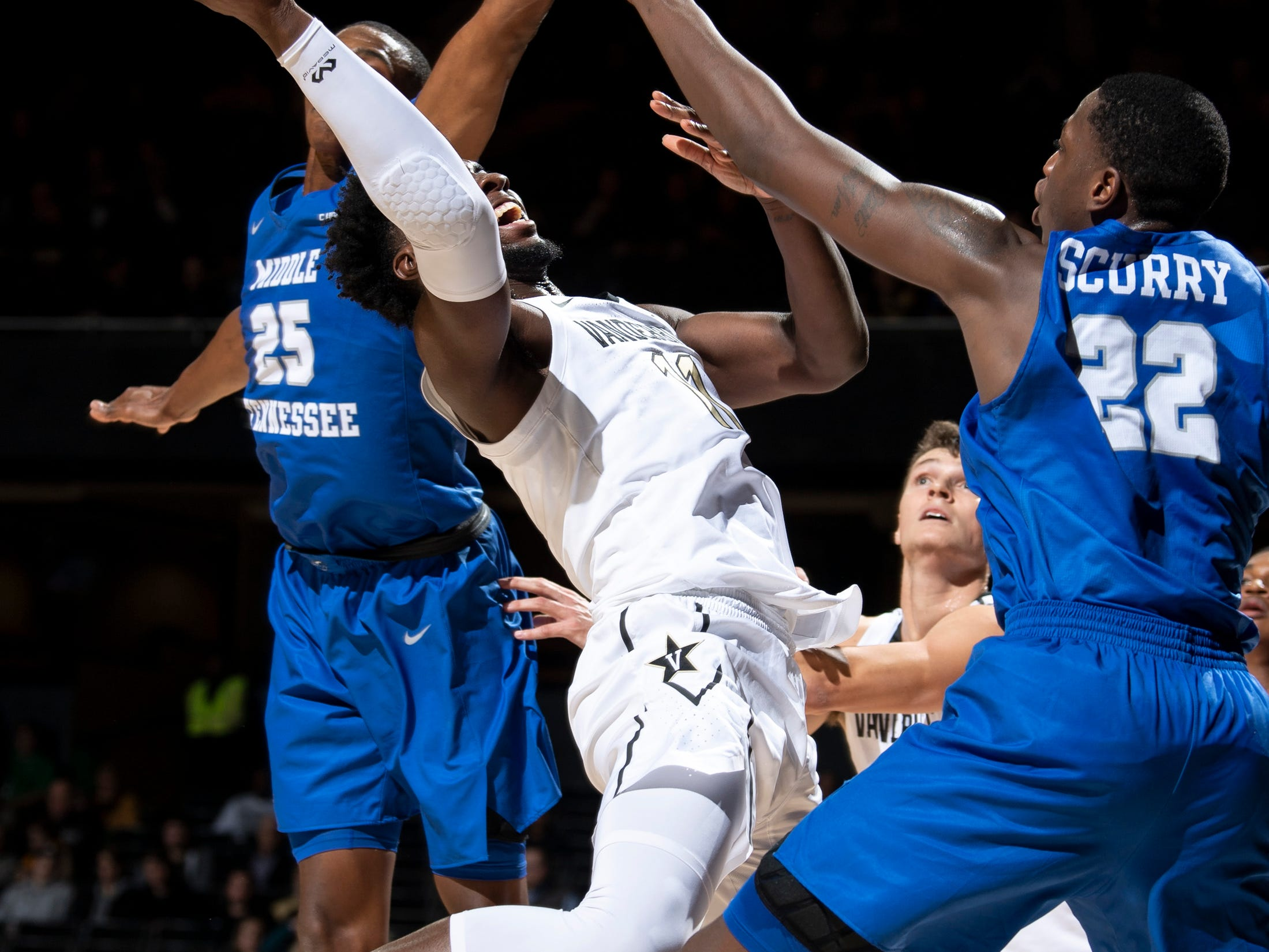 Vanderbilt forward Simisola Shittu (11) shoots into MTSU forward Reggie Scurry (22) and forward Karl Gamble (25) during the first half at Memorial Gym in Nashville, Tenn., Wednesday, Dec. 5, 2018.
