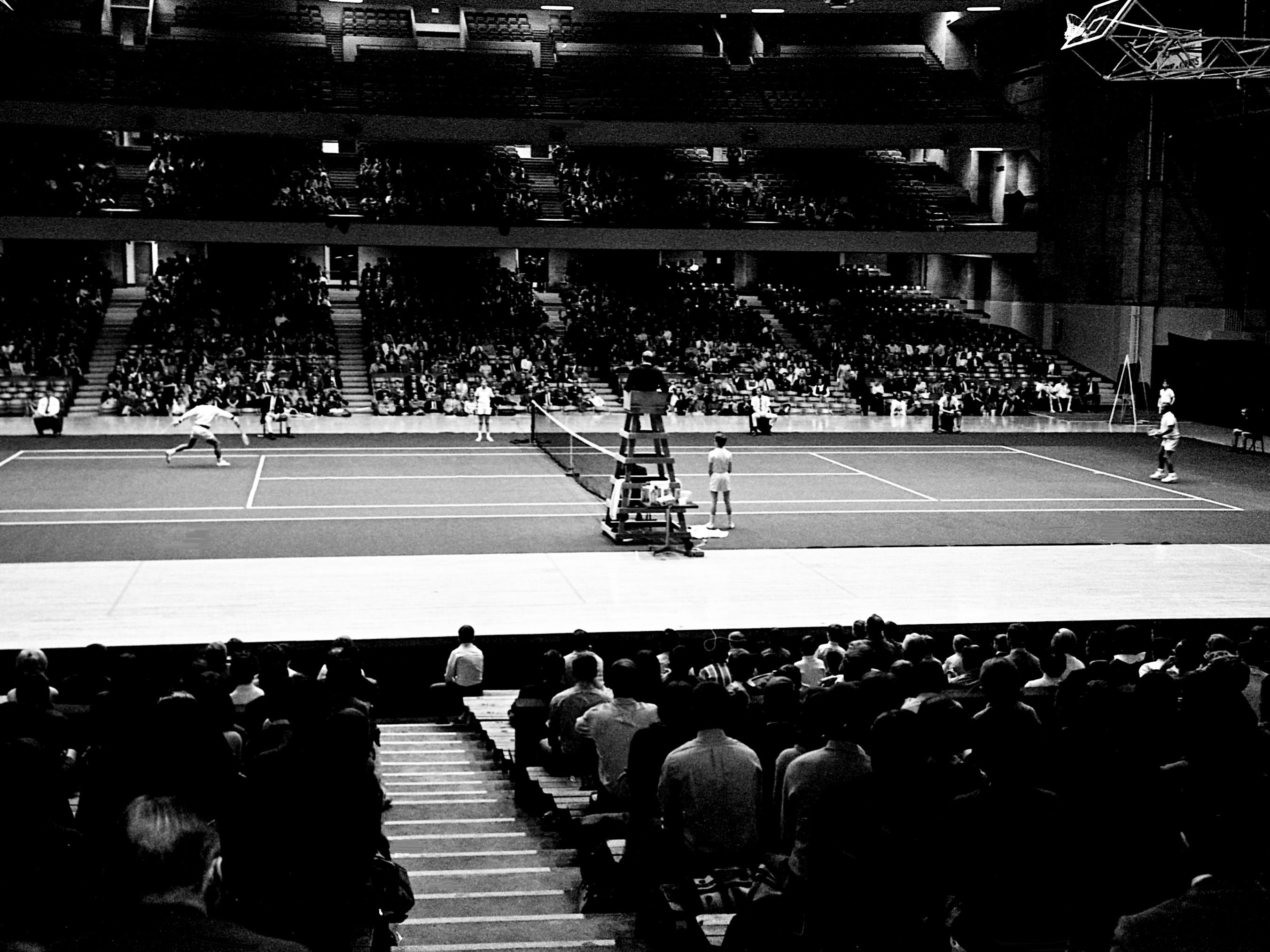An opening night crowd of more than 4,000 watches as Pancho Segura and Ken Rosewall play the first match of the Dixie Tennis Classic at Vanderbilt's Memorial Gym on Dec. 7, 1968. Rosewall won 6-1, 6-2.