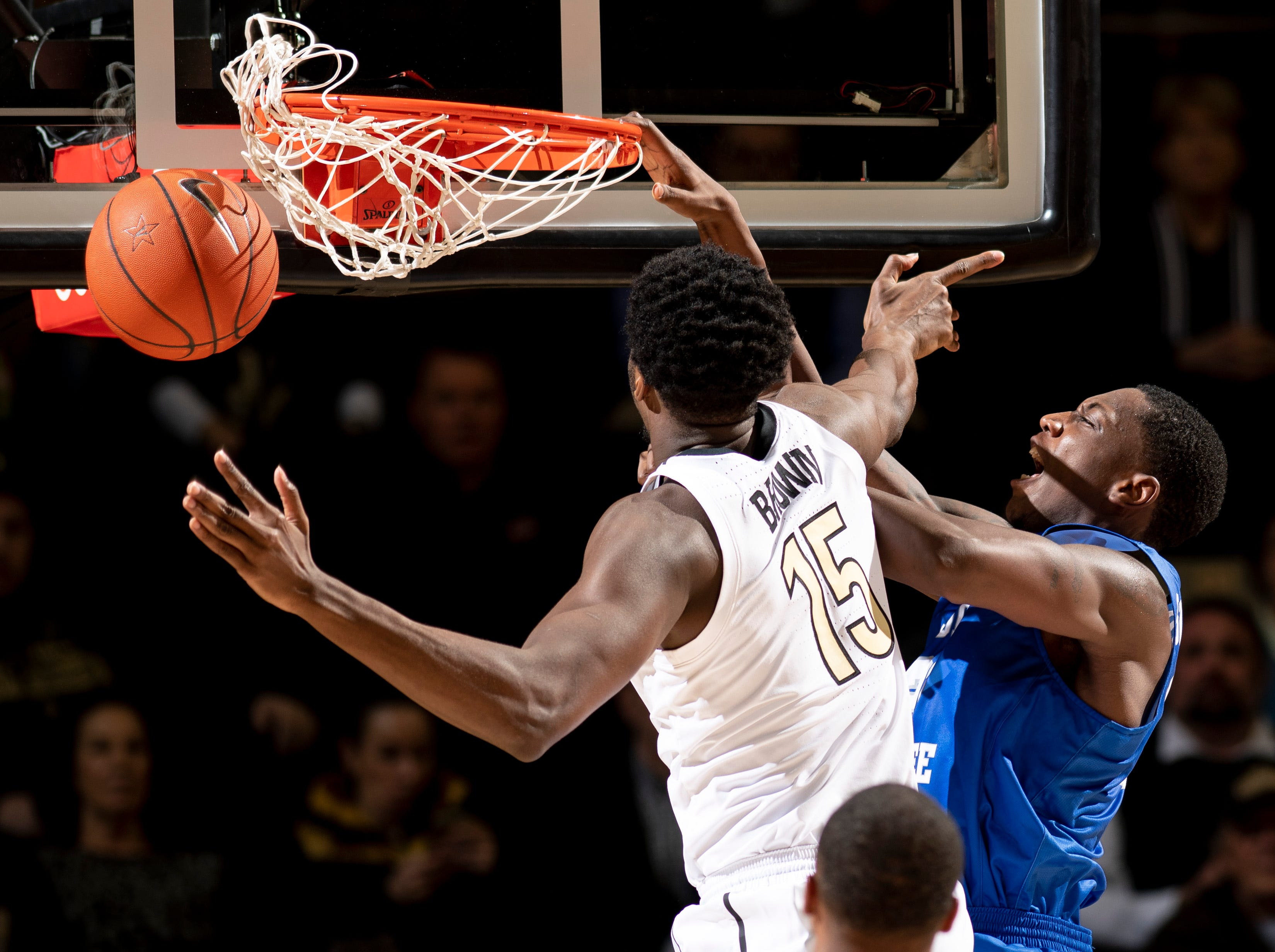MTSU forward Reggie Scurry (22) dunks past Vanderbilt forward Clevon Brown (15) during the first half at Memorial Gym in Nashville, Tenn., Wednesday, Dec. 5, 2018.
