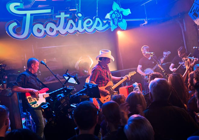"""Brad Paisley performs as he shoots a video for his new song """"Bucked Off"""" at Tootsie's Orchid Lounge Wednesday, Dec. 5, 2018, in Nashville, Tenn."""