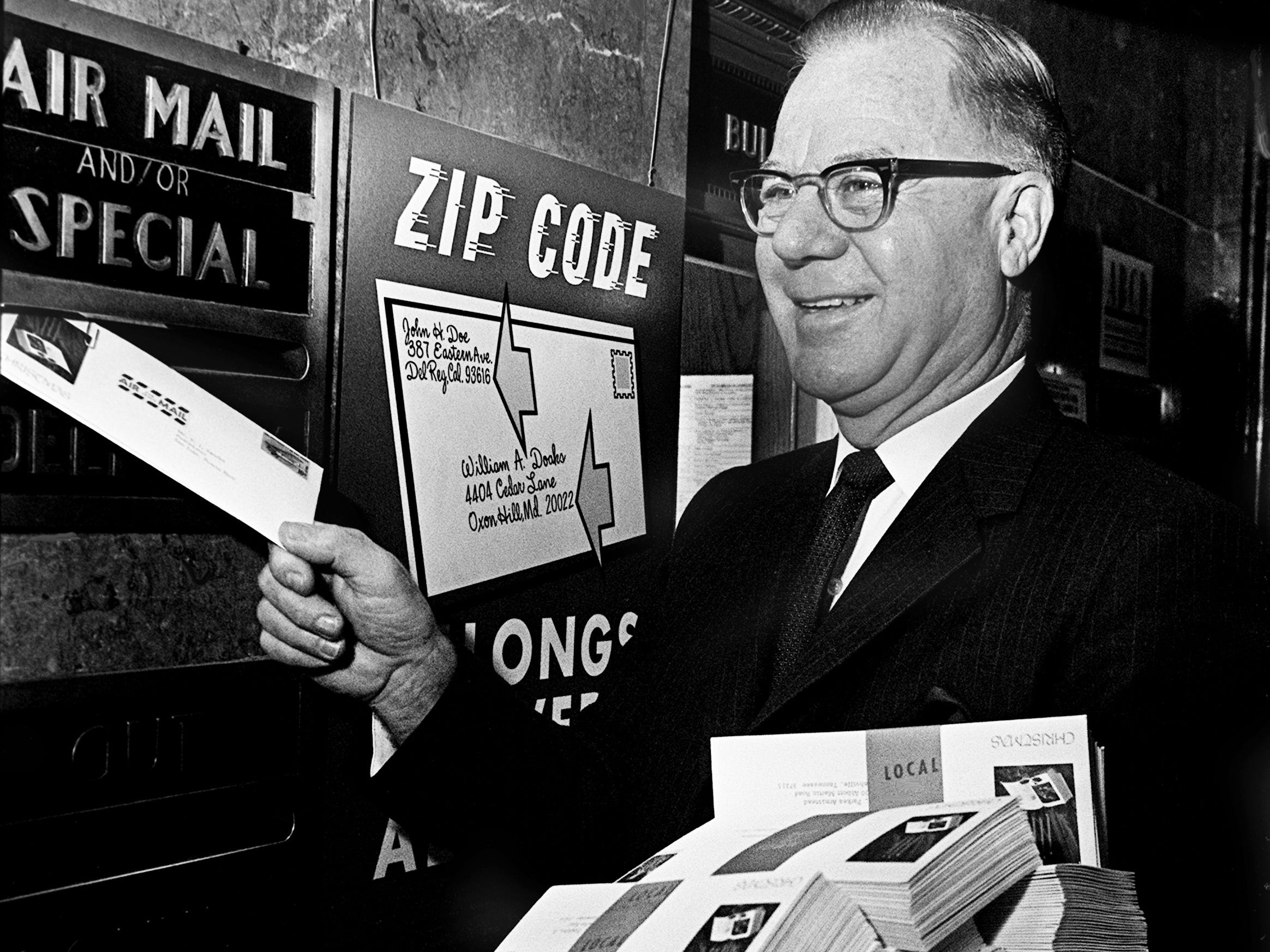 Nashville Postmaster Lewis Moore practices what he asks patrons to do as he mails his Christmas cards early Nov. 30, 1968. Moore suggest that cards be mailed during the early part of the day to avoid the backlog in the afternoon.