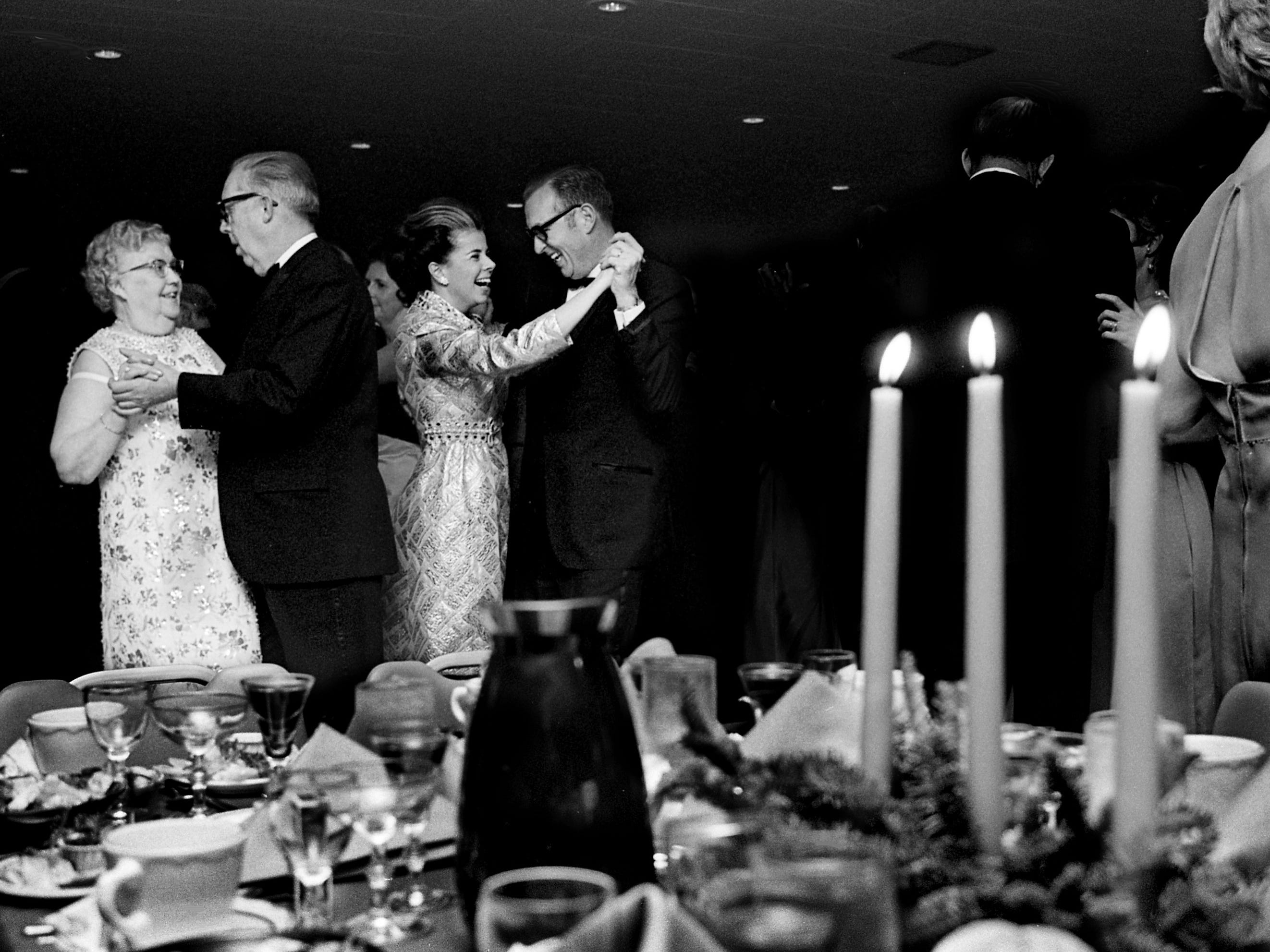 Dancing to the music of Marshall Grant's Palm Beach orchestra are Mrs. John Youmans, left, John DeWitt, and Mrs. and Dr. Irwin Eskind during the new Sheraton-Nashville's Opening Ball on Dec. 13, 1968.