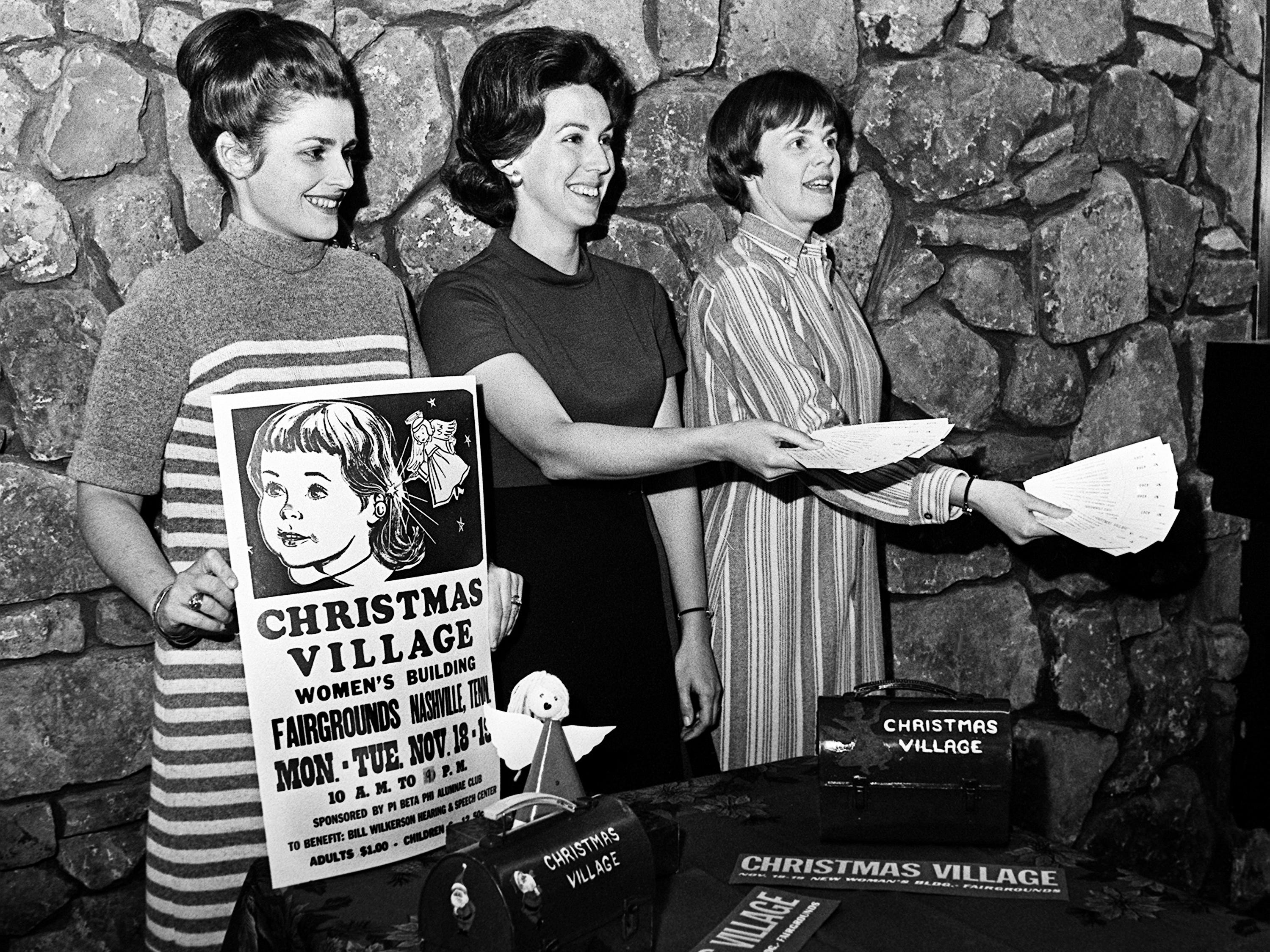 Mrs. James R. Kennedy, left, Mrs. William Westermann, and Mrs. Bruce Crabtree Jr. are selling tickets Nov. 12, 1968 for the upcoming annual Christmas Village to be held at the Women's Building at the State Fairgrounds. The affair, sponsored by Pi Beta Phil Alumnae Club, benefits Bill Wilkerson Hearing and Speech Center.