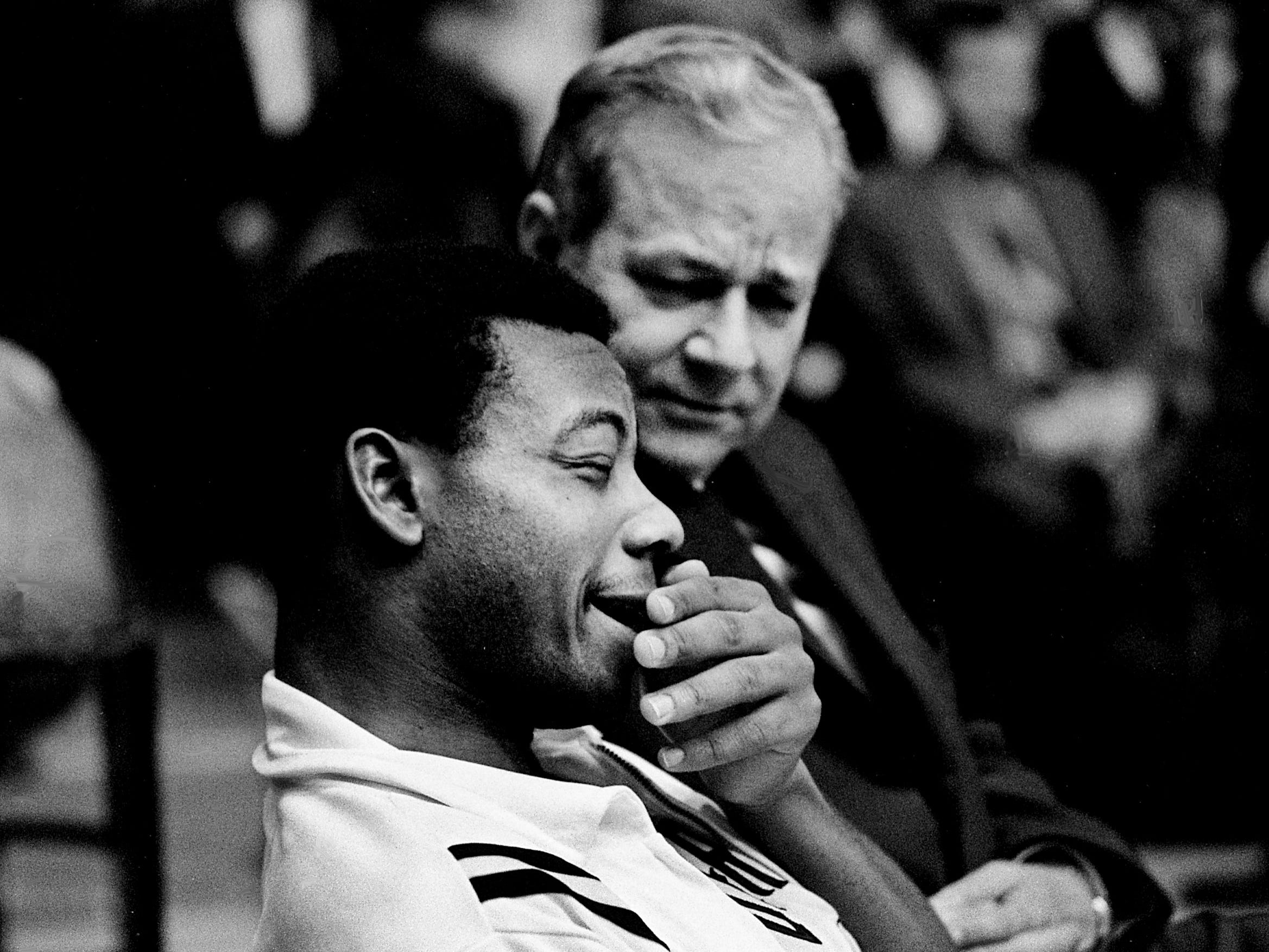 Vanderbilt junior forward Perry Wallace, left, gets a visit from the school's senior vice chancellor, Rob Roy Purdy, during the halftime of the Commodores' 92-67 victory over Bowling Green State at Memorial Gym on Dec. 16, 1968. Perry, sustained a bruised eye after nine minutes of play and missed the rest of the game.
