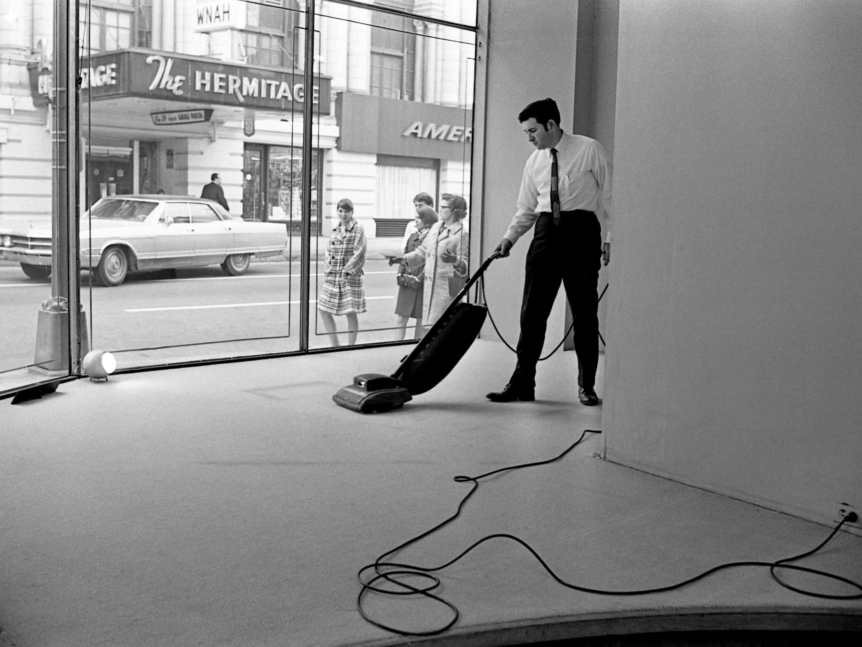 Don Brandes, salesman at Chayburke's on Sixth Avenue across from the Hermitage Hotel in downtown Nashville, begins the day after Christmas task of cleaning up Dec. 26, 1968.