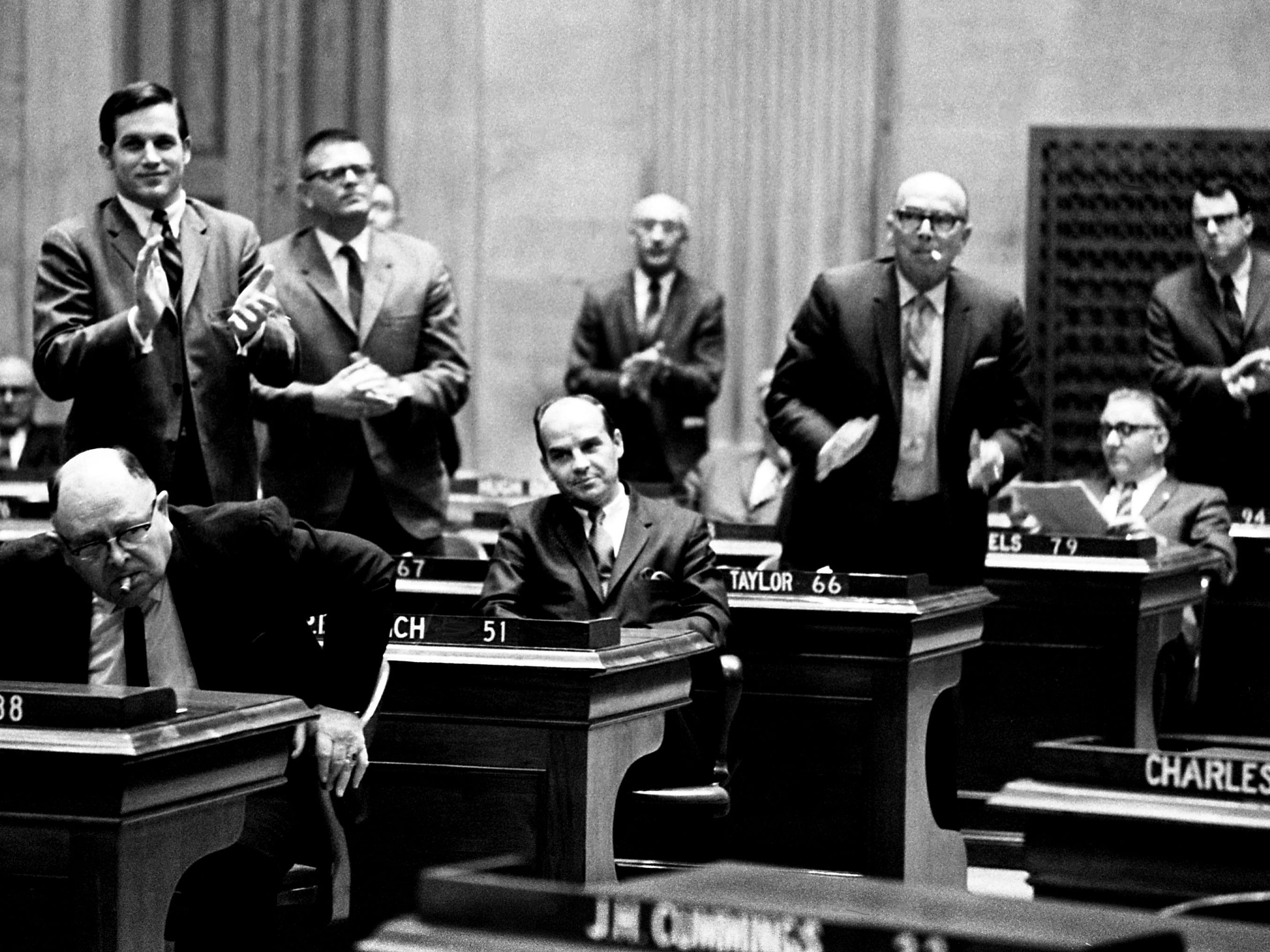Democrats in the state House of Representatives rise to applaud Rep. Pat Lynch, D-Winchester, center, after selecting him Dec. 20, 1968, as the party candidate for House speaker.