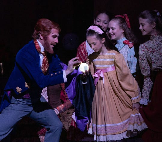 Jon Upleger as Uncle Drosselmeyer with Nashville's Nutcracker Youth Cast members.