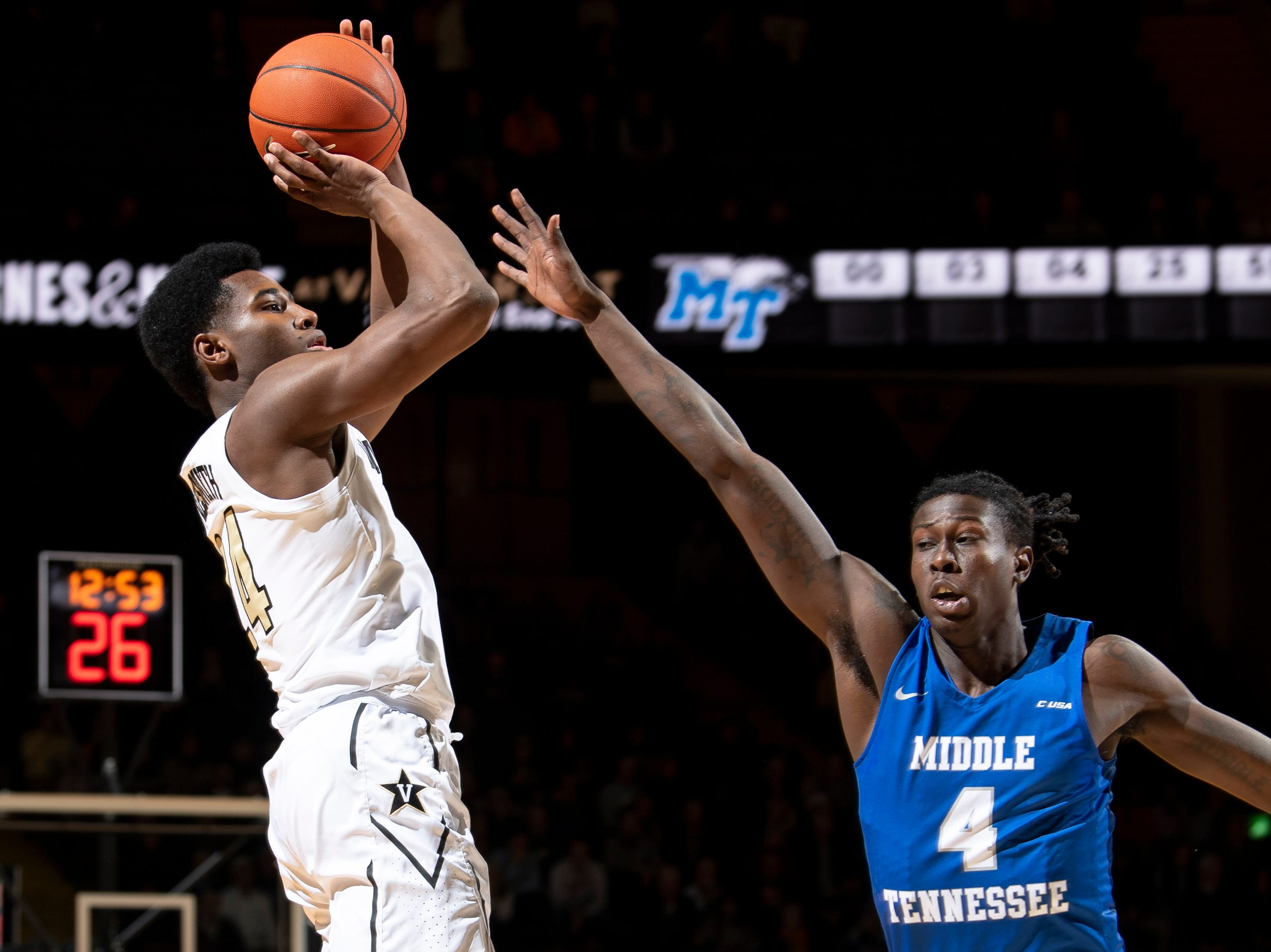 Vanderbilt forward Aaron Nesmith (24) shoots over MTSU forward James Hawthorne (4) during the first half at Memorial Gym in Nashville, Tenn., Wednesday, Dec. 5, 2018.