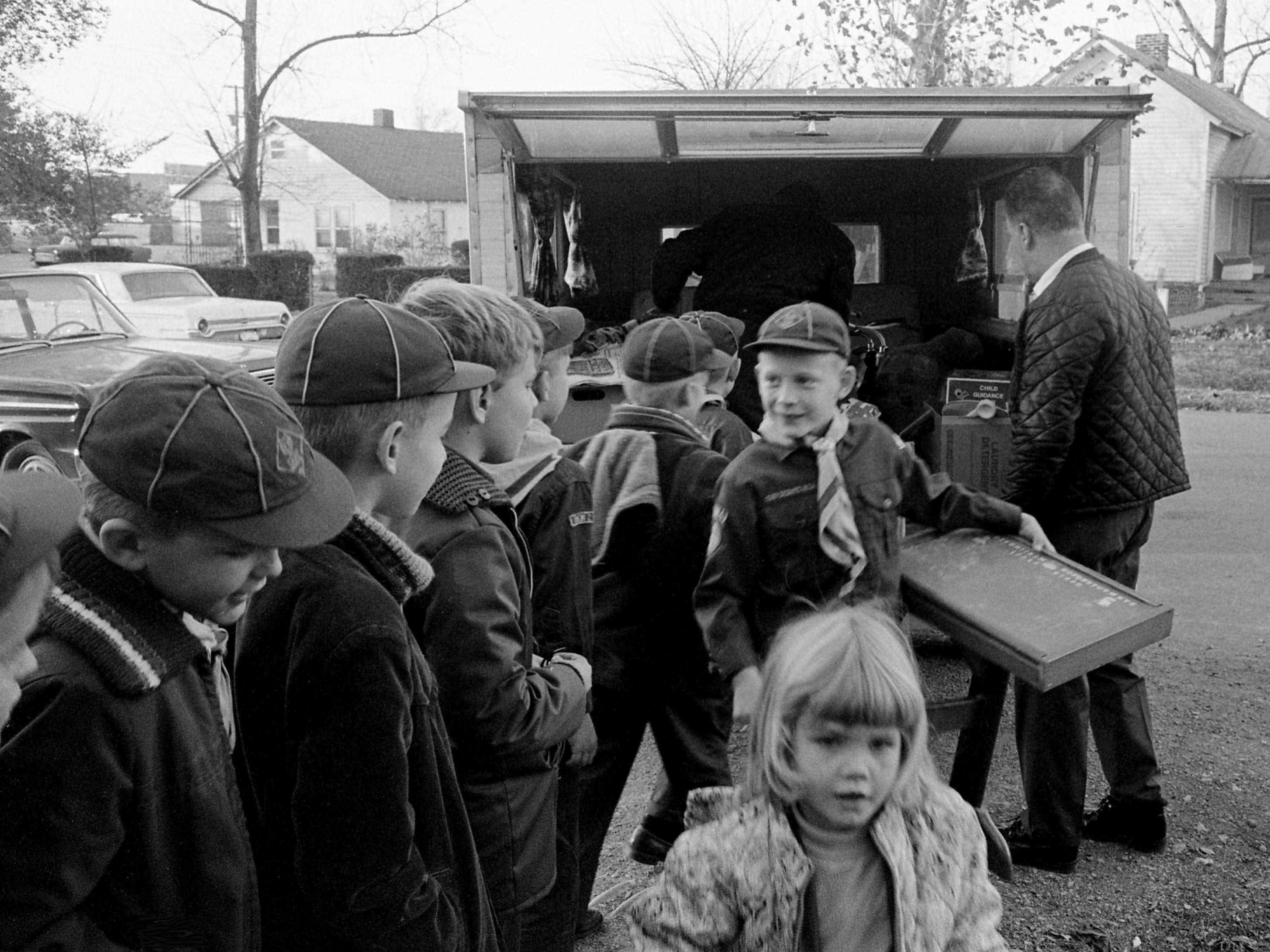 Cub Scouts from White's Creek Pack 292 unload toys at St. Luke's Community Center on New York Ave. Nov. 21, 1968 after collecting them in the community. St. Luke's will distribute the toys to underprivileged children during the Christmas holidays.