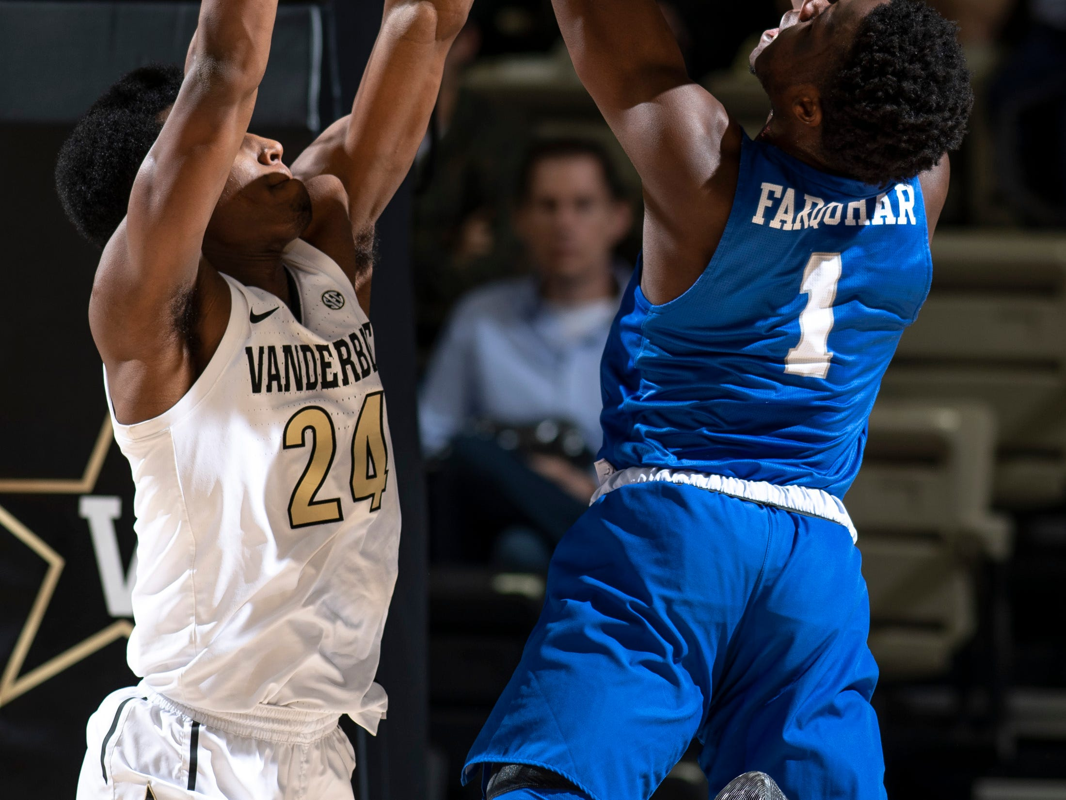Vanderbilt forward Aaron Nesmith (24) defends against MTSU guard Junior Farquhar (1) during the second half at Memorial Gym in Nashville, Tenn., Wednesday, Dec. 5, 2018.