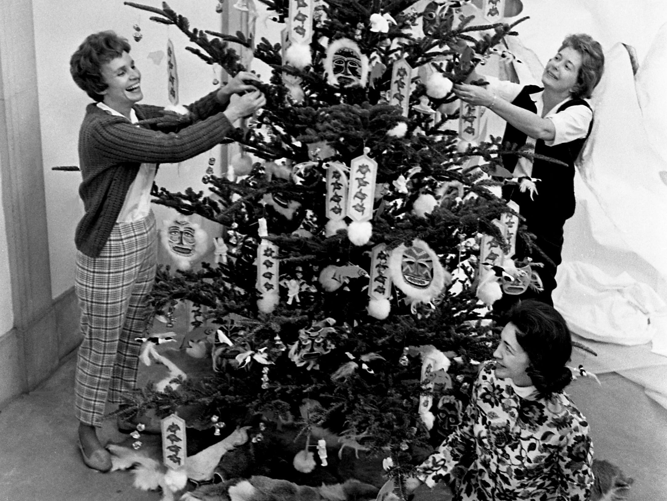 Members of the Green Hills Garden Club are putting the finishing touches Dec. 3, 1968 to the Alaskan tree, one of the seven new trees for the upcoming 4th annual Christmas at Cheekwood event. They are Mrs. Bob Mason, left, Mrs. Charles Gaw and Mrs. Harold West.