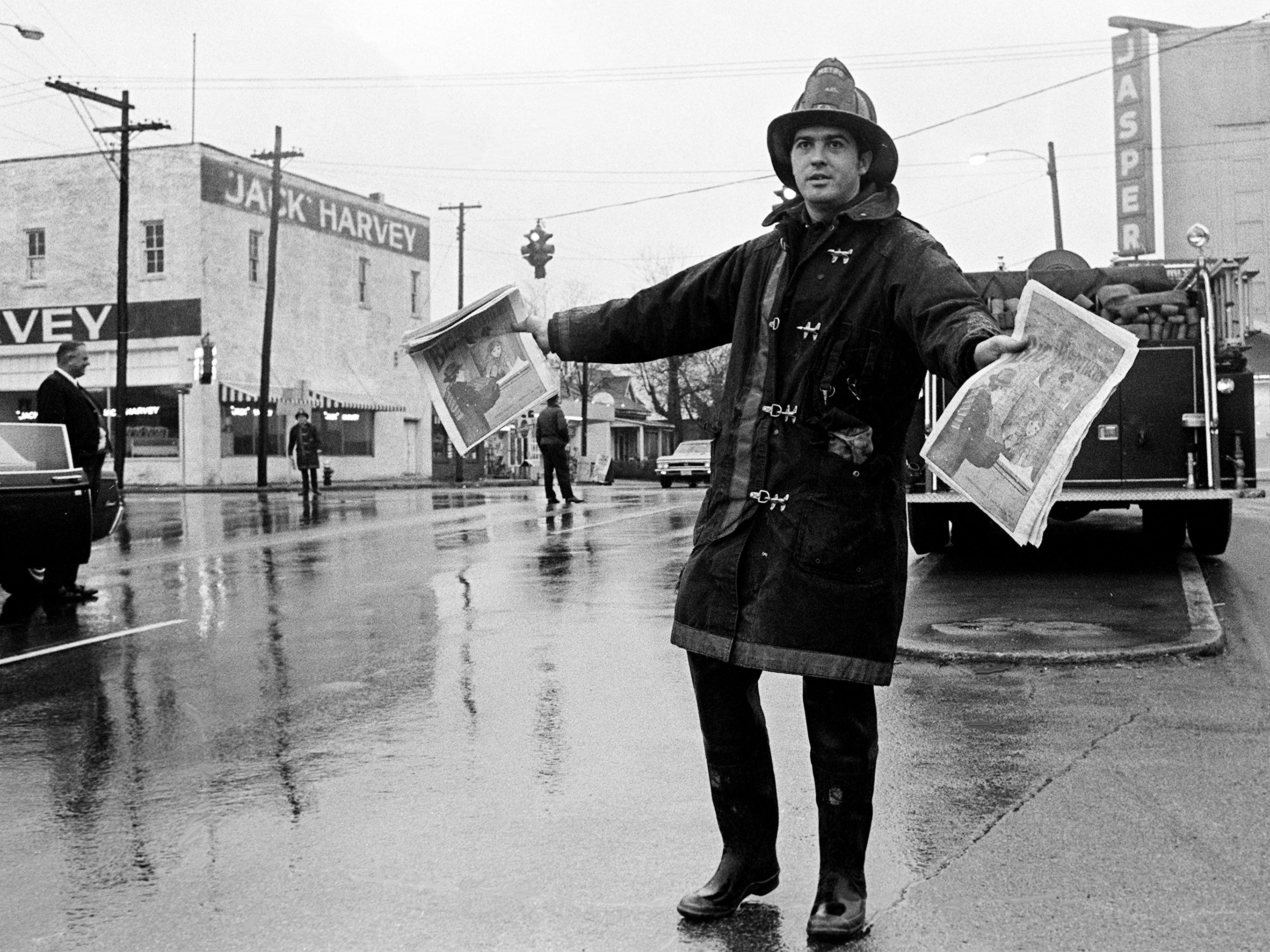Metro Fireman Billy R. Carrigan of Ridgewood Road, displays the smartest attire for workers in the rain-soaked Big Brothers annual Christmas tabloid sale Dec. 22, 1968.