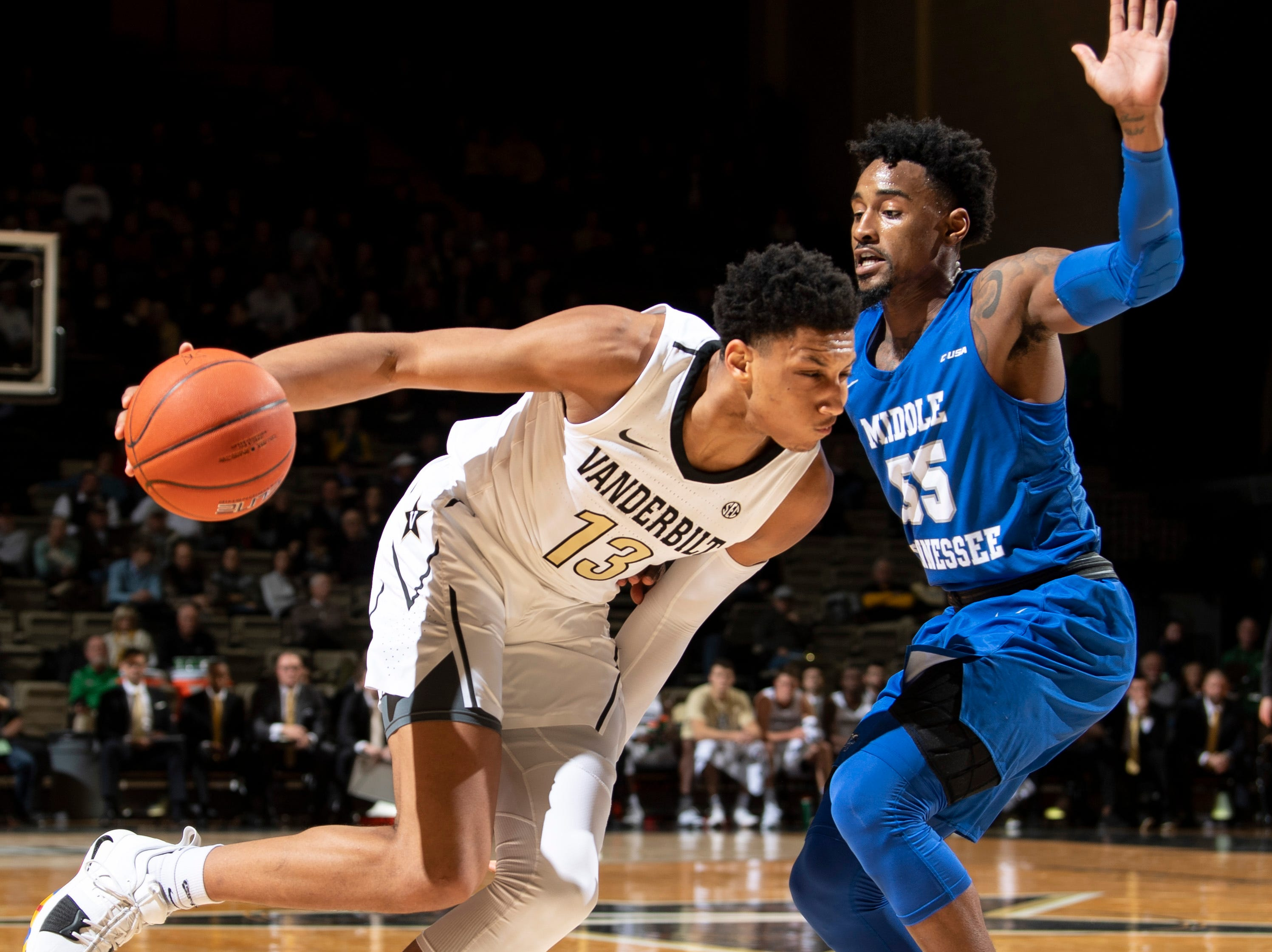 Vanderbilt forward Matthew Moyer (13) advances into MTSU guard Antonio Green (55)during the first half at Memorial Gym in Nashville, Tenn., Wednesday, Dec. 5, 2018.