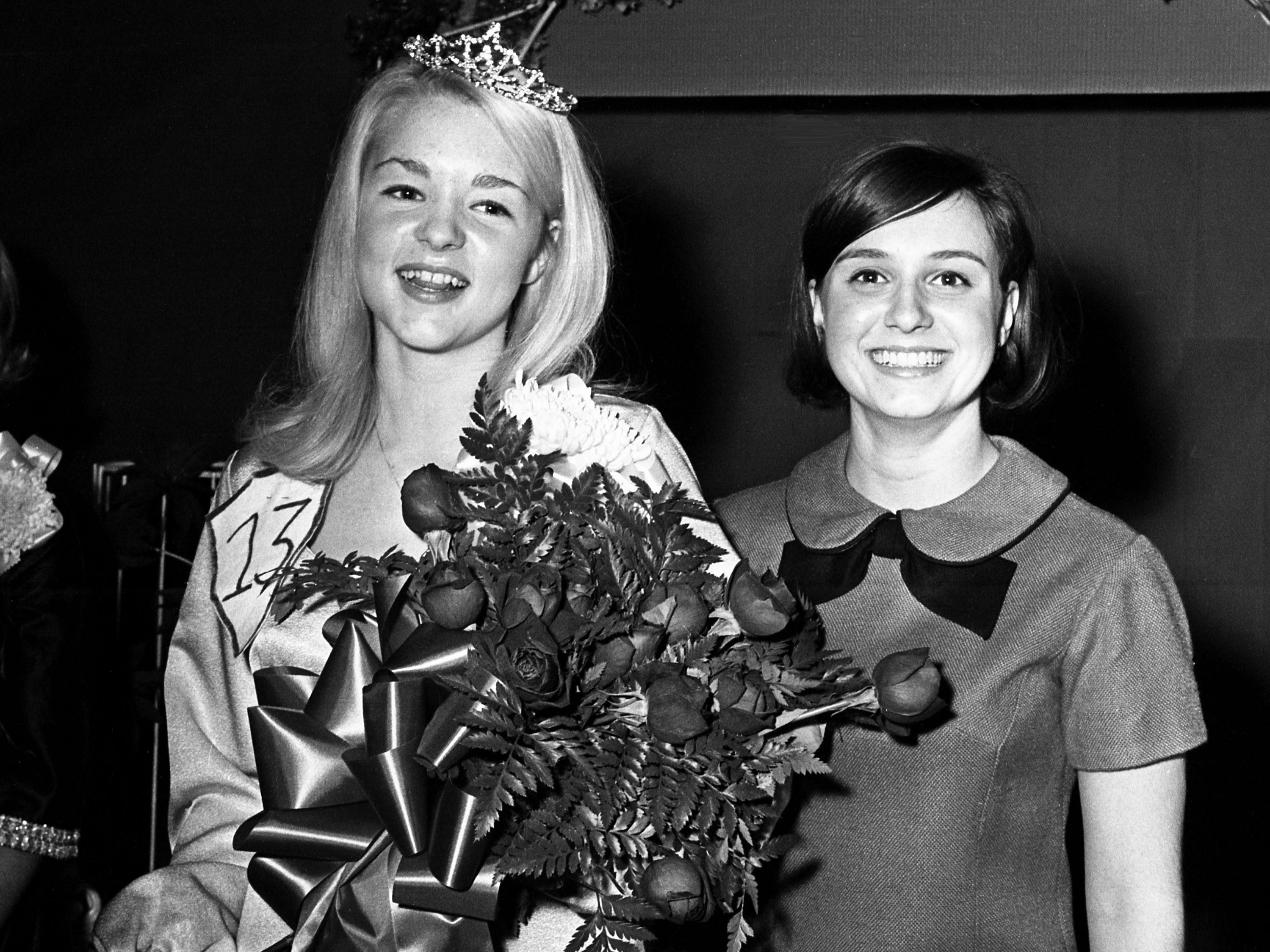 Crowned Woodbine Jaycee Club Christmas Queen Gloria Neese, left, of Nashville, smiles with delight Nov. 2, 1968. She is accompanied by last year's queen, Alicia White. Neese, 16, will participate in the Woodbine Christmas parade Dec. 1.