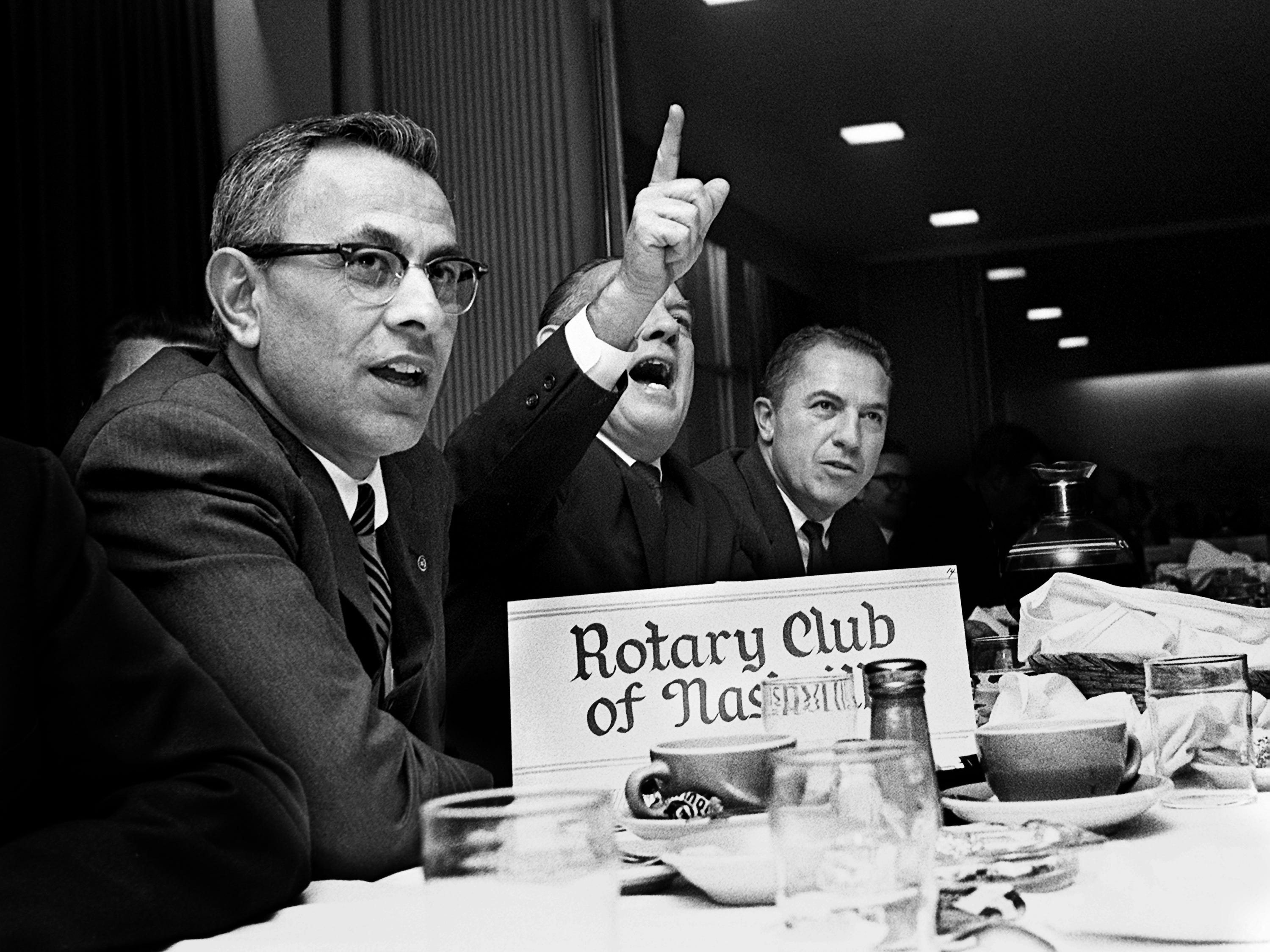 """""""Make it $5,000,"""" shouts Rotarian Club member Tom Summers, center, on his way to a """"$6,000 bid for the Glendale territory at the Big Brothers auction Dec. 9, 1968. Keeping an eye on the competition are fellow members Farris Deep, left, and Bill Krauth."""