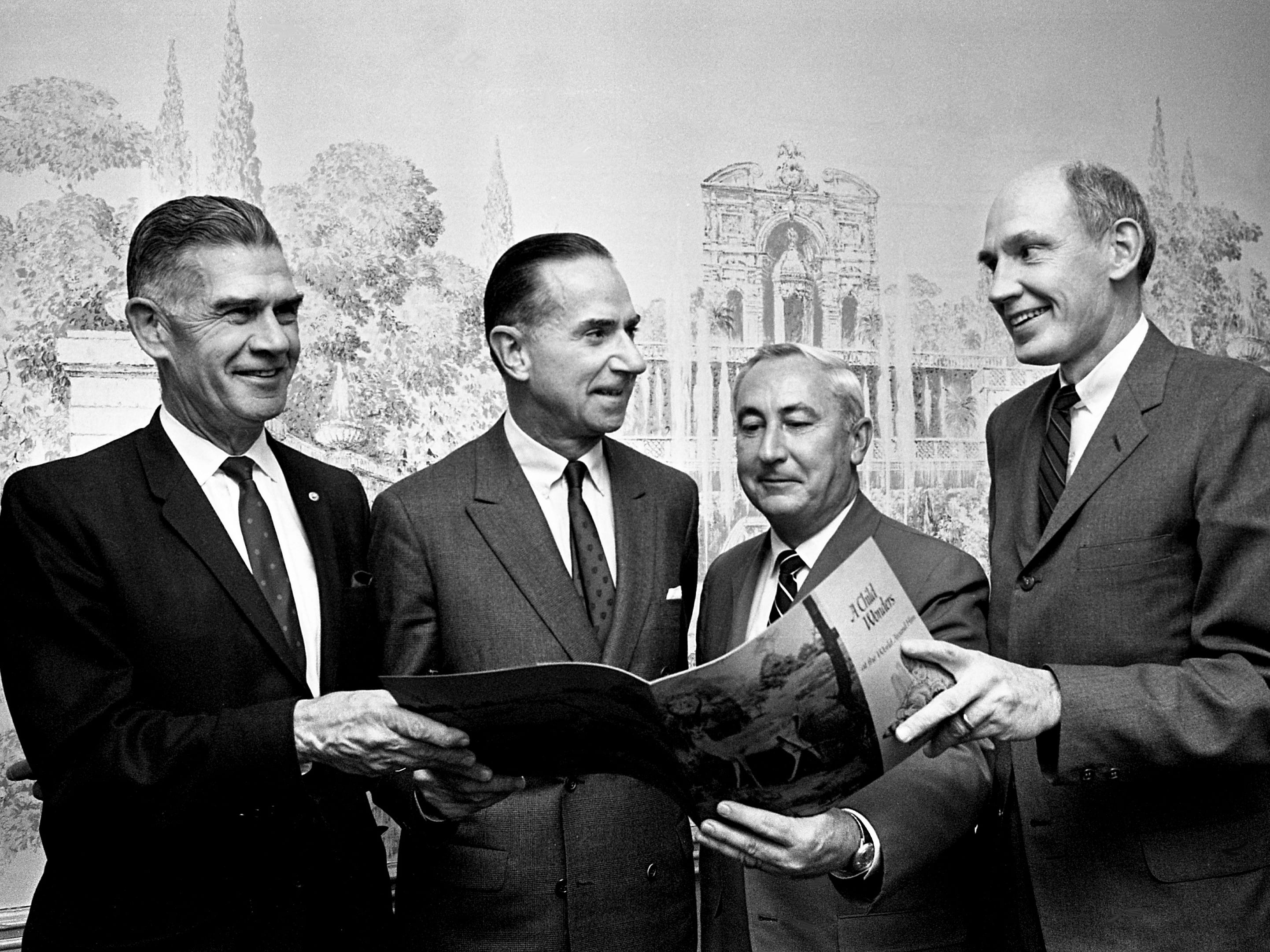 Dan W. Maddox, second from left, chairman of the board of Associates Capital Corp., discusses future plans for the new Nashville Children's Museum planned on the Fort Negley property after making a gift of $100,000 to the museum's fund drive during the board of trustees meeting at Belle Meade Country Club on Dec. 4, 1968. With Maddox, an internationally known big game hunter, are trustee Vernon Sharp, left, Charles R. Mott Jr., chairman of the fund drive, and museum president Joe Thompson.