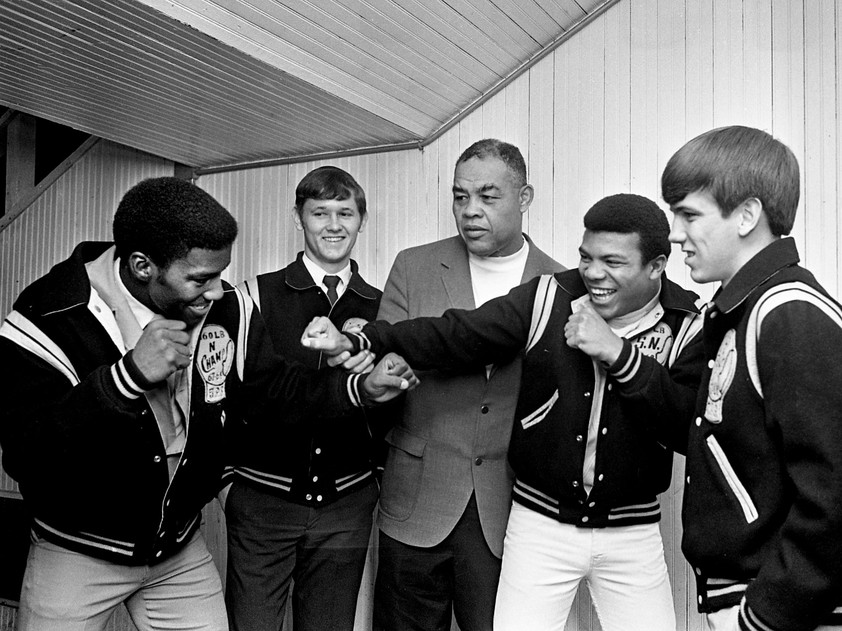 Former heavyweight champion Joe Louis, center, shares a moment with TPS boxers John Powell, left, Joel Grissom, Jimmy Sweatford and Tommy Cox at the Fairgrounds Coliseum on Dec. 4, 1968. Louis was in town to referee the wrestling matches at the Coliseum that night.