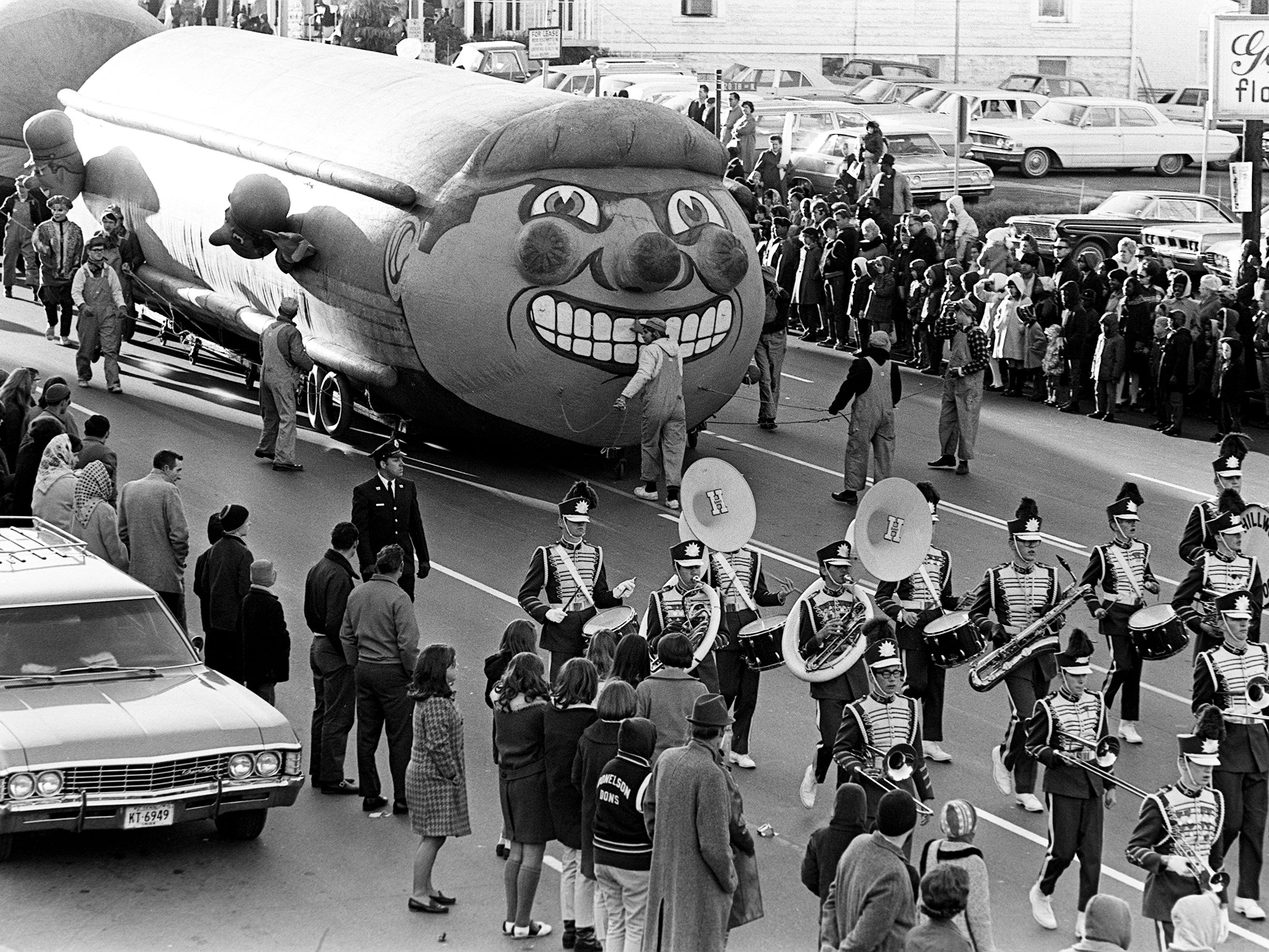 A grinning giant locomotive and the Hillwood High School marching band delight the estimated crowd of 125,000 during the 16th annual Nashville Christmas Parade on Dec. 8, 1968.