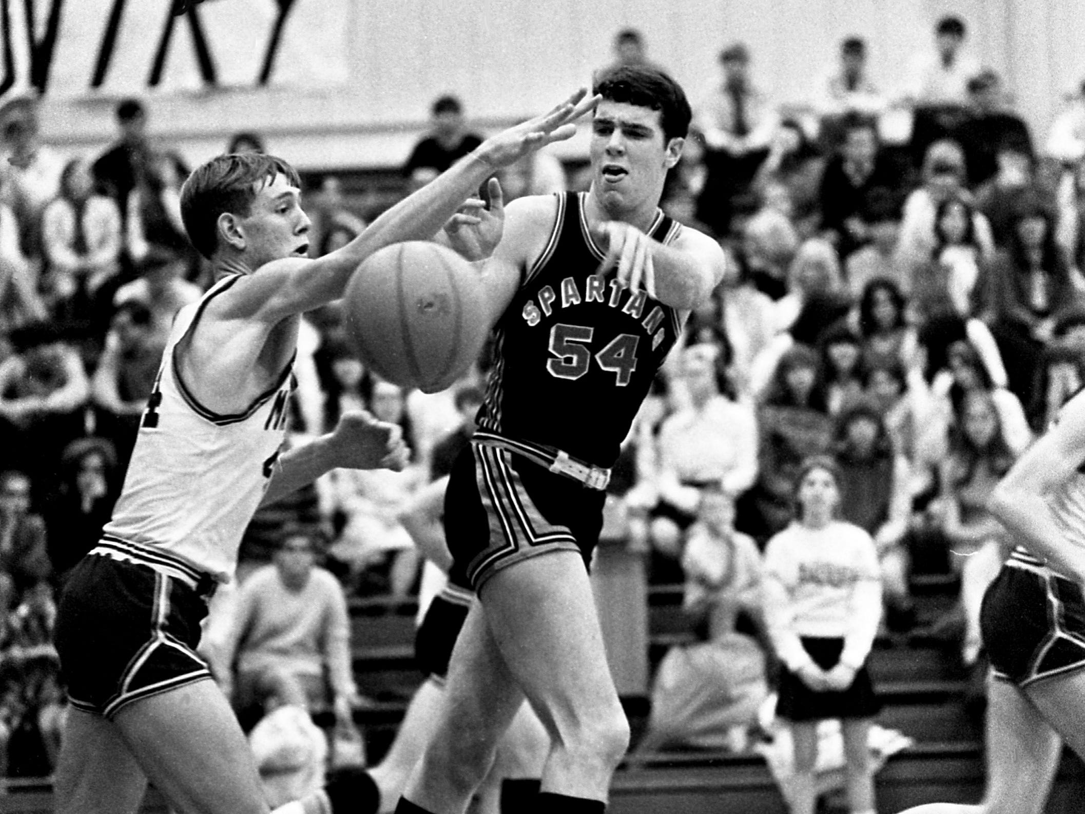 Stratford High 6-8 center Ray Maddux (54) battles with Maplewood High's Ken Lowery for control of the ball. Maddux, with 25 points and 21 rebounds, led Stratford to a 63-49 win on the road against Maplewood on Dec. 10, 1968.
