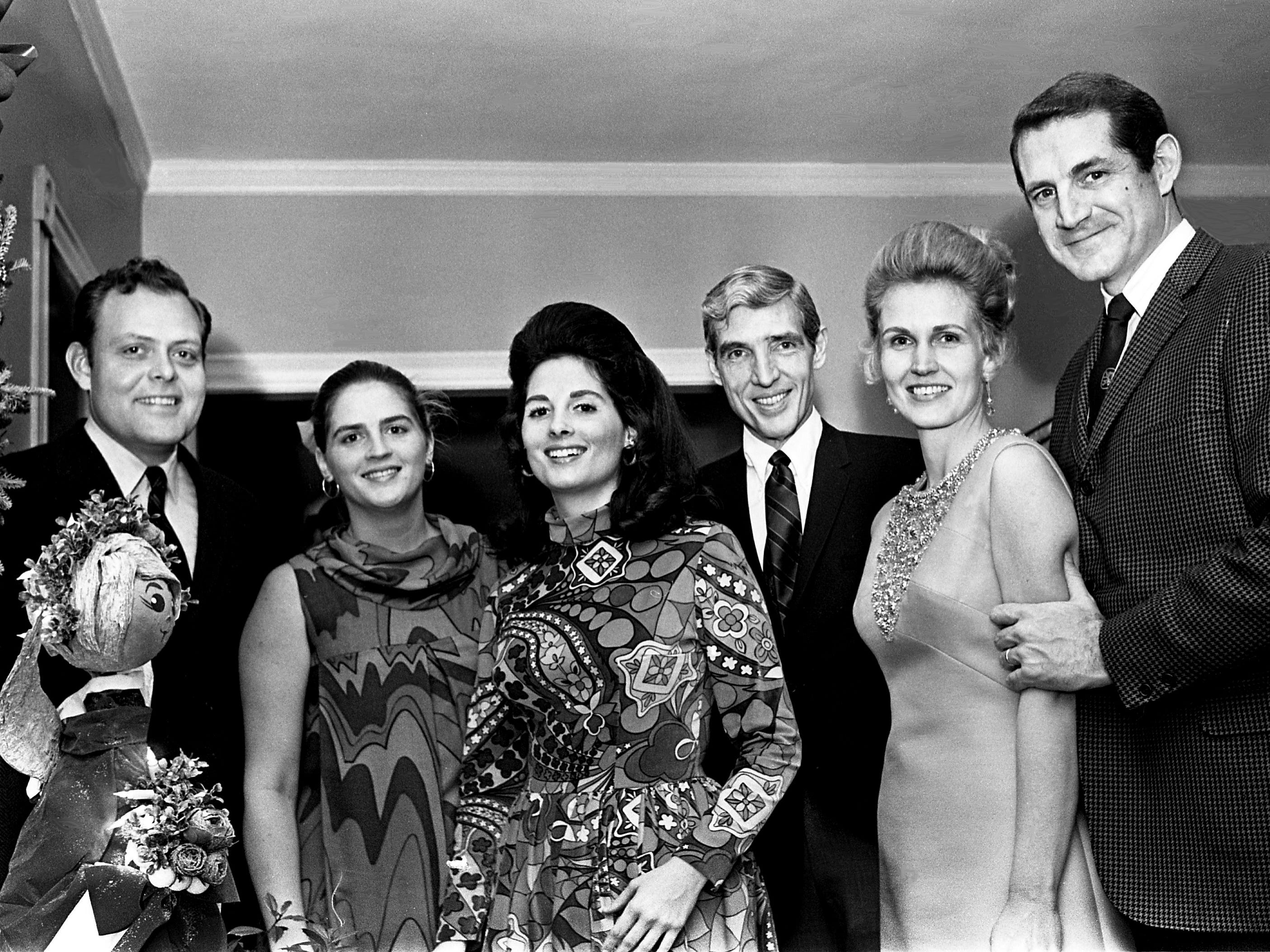 Host Tish Hooker, third from left, shares a moment with guests Mr. and Mrs. Gil Merritt, left, Thomas W. Steele, Mrs. and Mr. Stirton Oman as she and her husband John J. Hooker Jr. have a holiday party in the Belle Meade Apartment of his mother, Mrs. Darthula Hooker, Dec. 22, 1968. The Hookers are staying with his mother while their home on Chickering Lane is under construction.