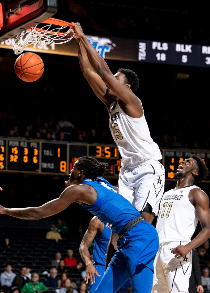 Vanderbilt forward Clevon Brown (15) dunks over MTSU forward James Hawthorne (4) during the second half at Memorial Gym in Nashville, Tenn., Wednesday, Dec. 5, 2018.