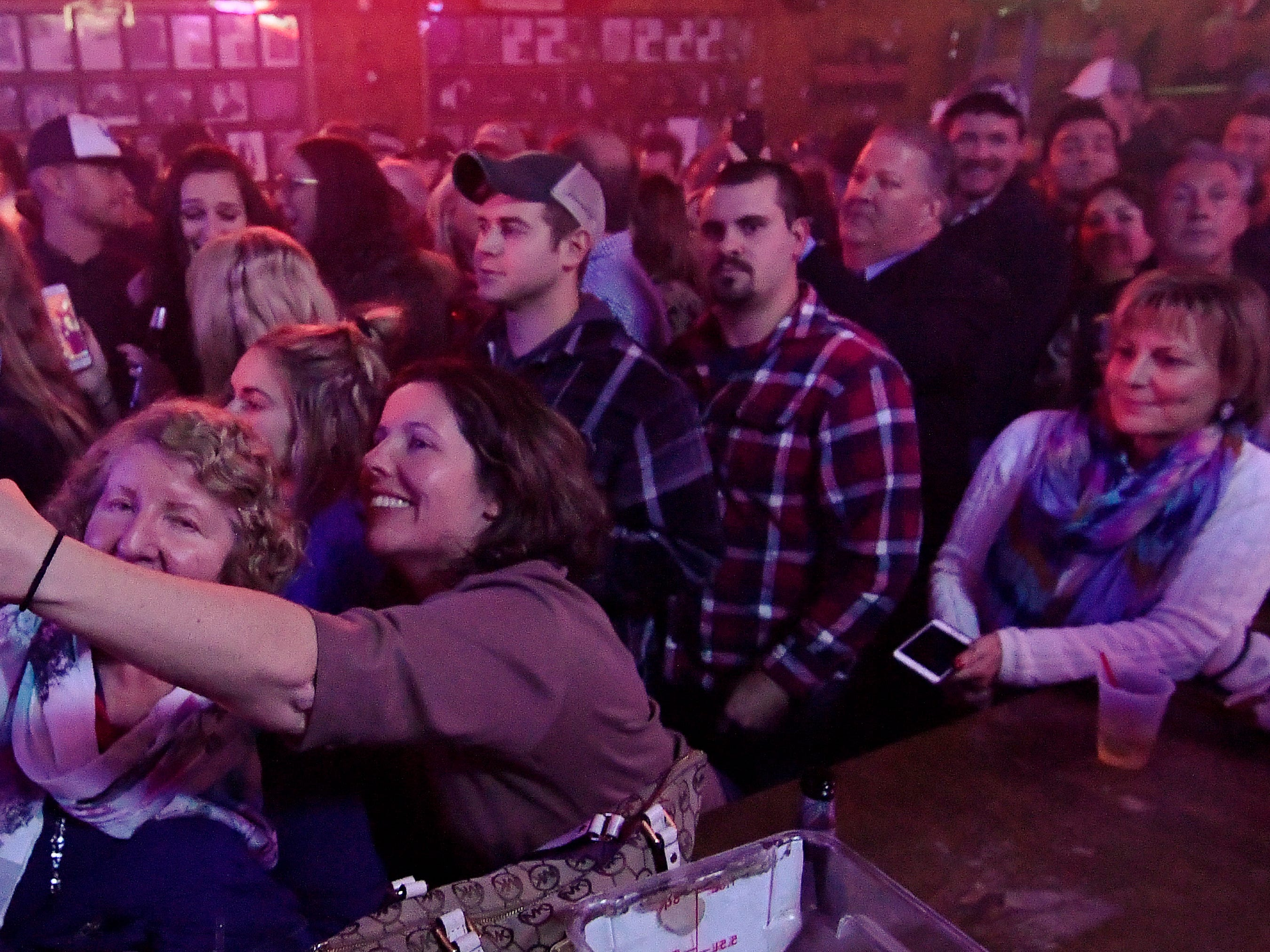 "Brad Paisley fans enjoy taking part in a video for his new song ""Bucked Off"" at Tootsie's Orchid Lounge Wednesday, Dec. 5, 2018, in Nashville, Tenn."