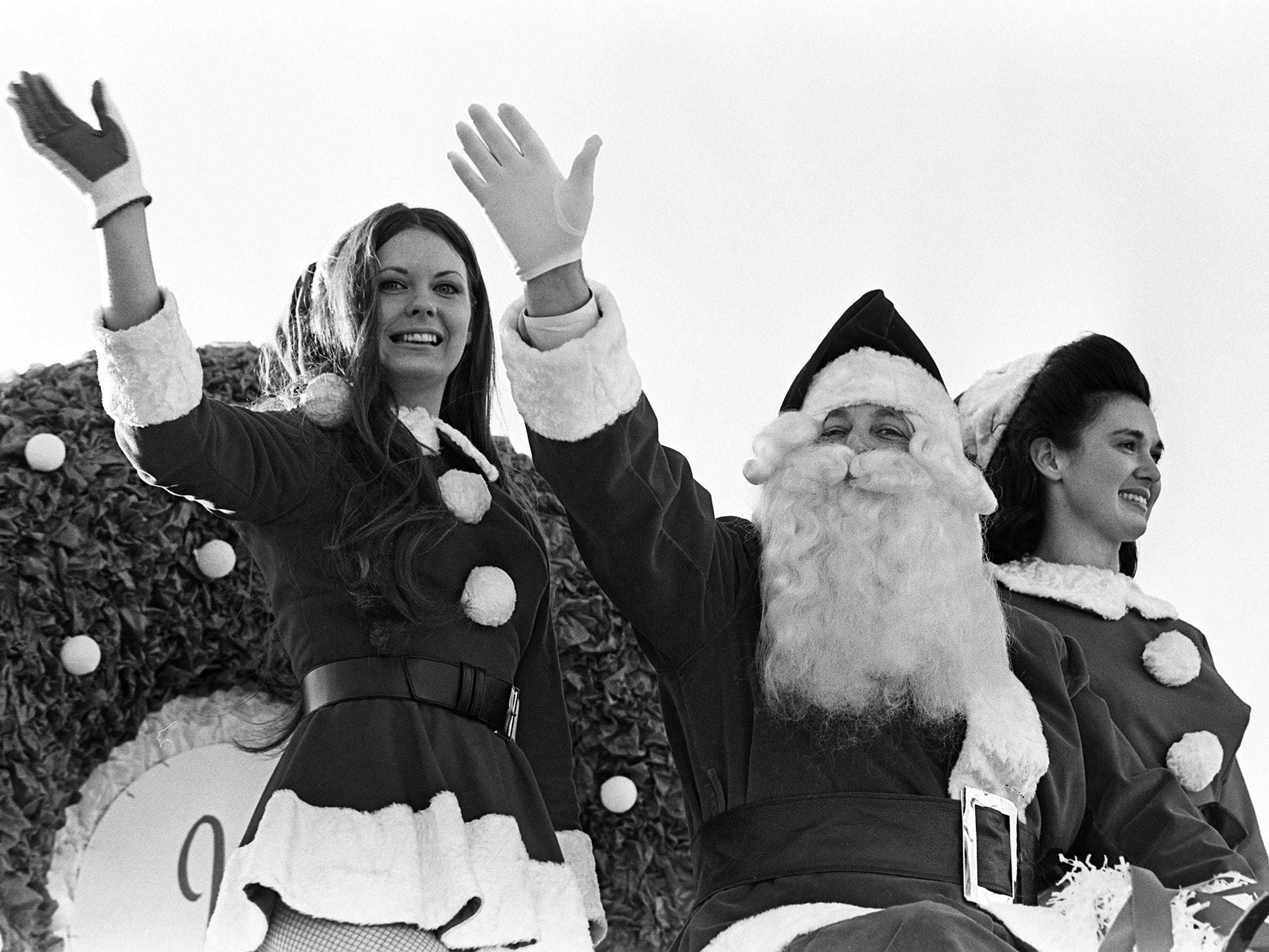 Santa Claus and his two helpers wave to the estimated crowd of 125,000 at the 16th annual Nashville Christmas Parade on Dec. 8, 1968.