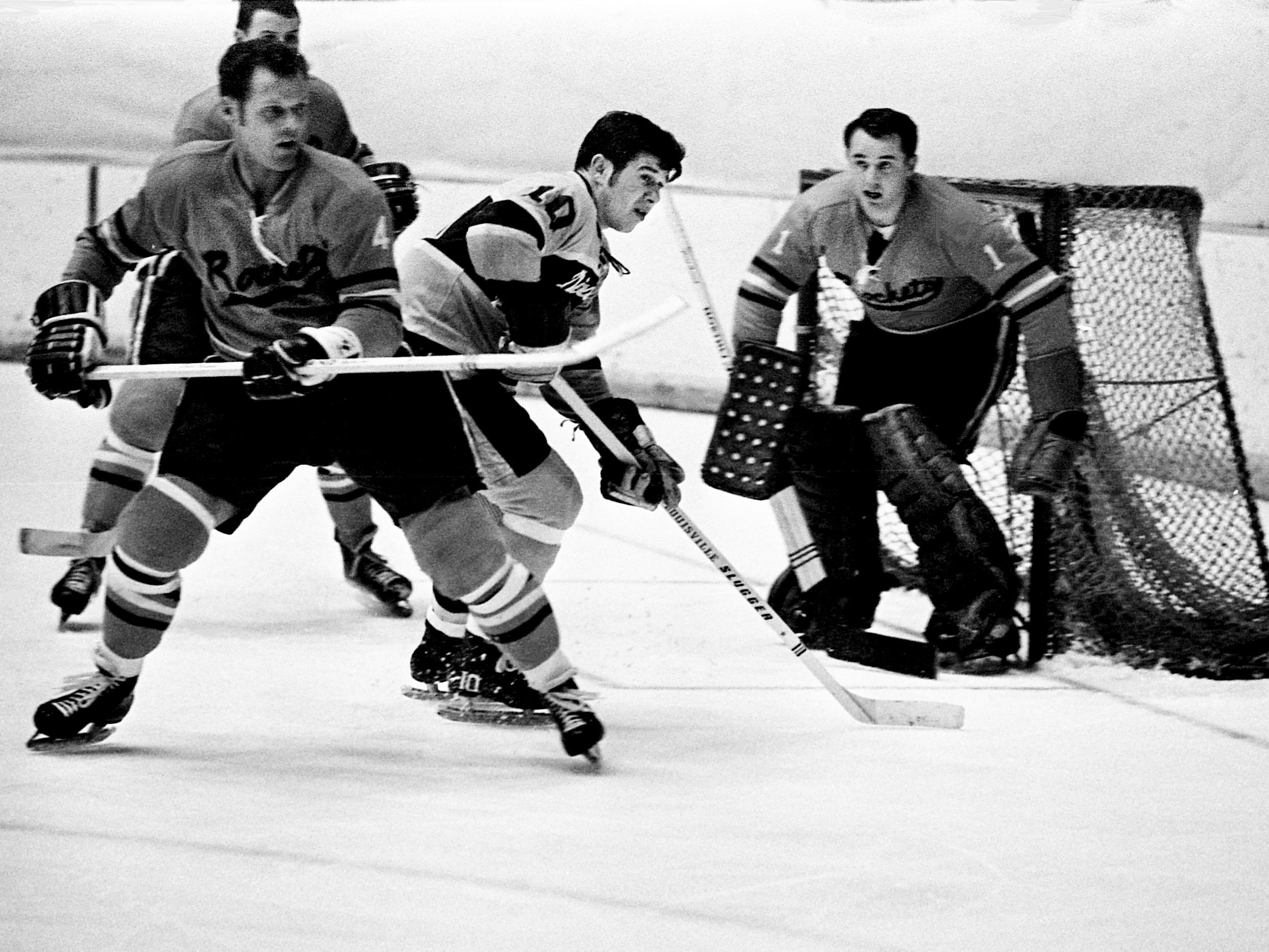 Nashville Dixie Flyers winger Andre Lajeunesse (10) positions himself in the middle of a trio of defense from the Jacksonville Rockets, including defenseman Stan Melanchuck (4) and goalie Harrison Gray. The Flyers won 8-3 before a Christmas Day crowd of 2,173 at Municipal Auditorium on Dec. 25, 1968.